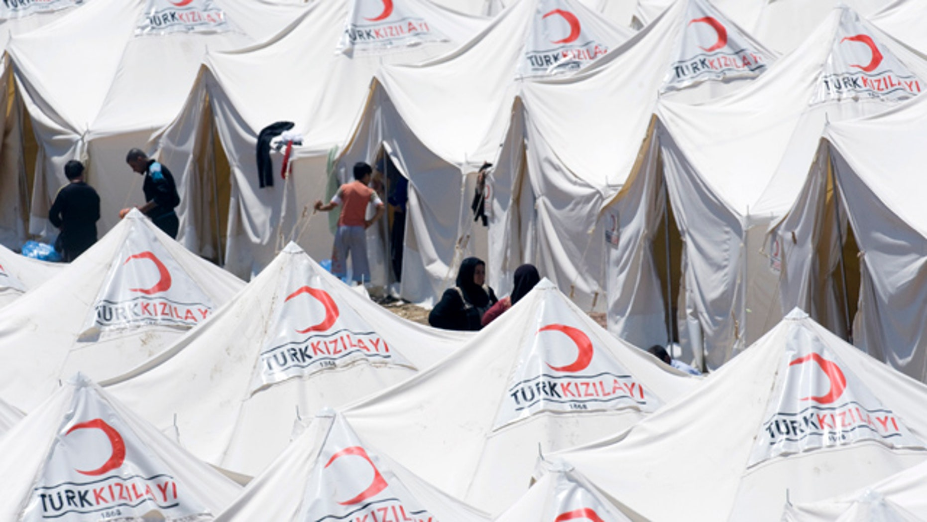 June 19: Syrian refugees are seen in a newly opened refugee camp in Yayladagi, Turkey.