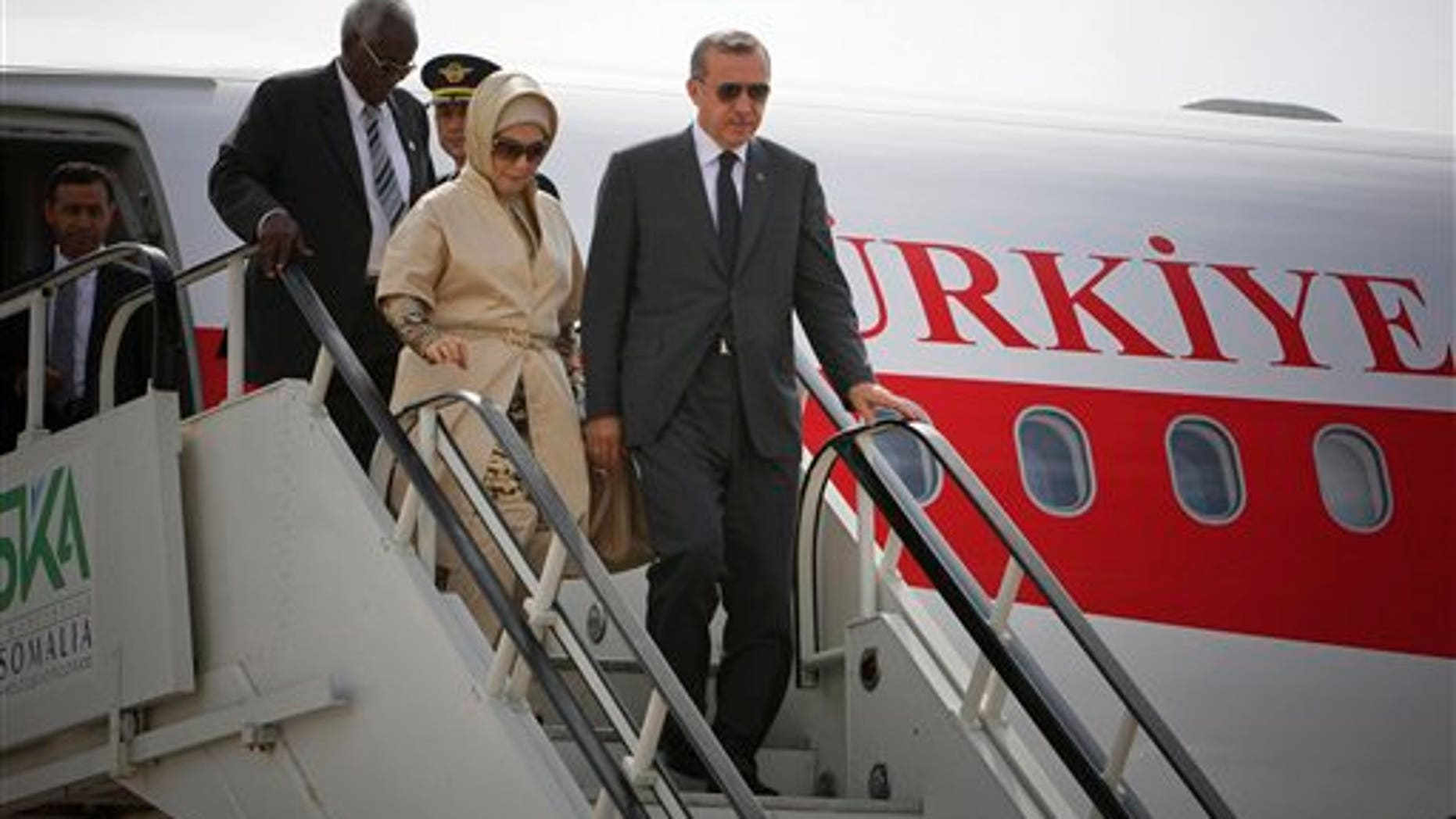 August 19: Turkish Prime Minister Recep Tayyip Erdogan and his wife Emine Erdogan disembark from their plane at Aden Abdulle International Airport on their first official visit to Somalia.
