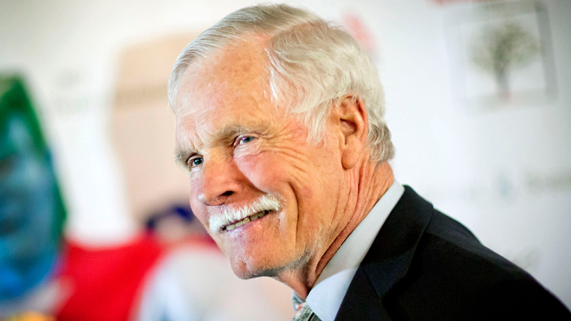 """FILE - In this Friday, Dec. 6, 2013 file photo, American media mogul Ted Turner is photographed on the red carpet at the Captain Planet Foundation benefit gala in Atlanta. Turner Enterprises spokesman Phillip Evans in Atlanta said the CNN founder was hospitalized in South America and that """"no further details will be provided."""" CNN's news desk, tweeted that Turner was """"under observation"""" Friday, March 7, 2014, at a hospital in Buenos Aires. (AP Photo/David Goldman, File)"""