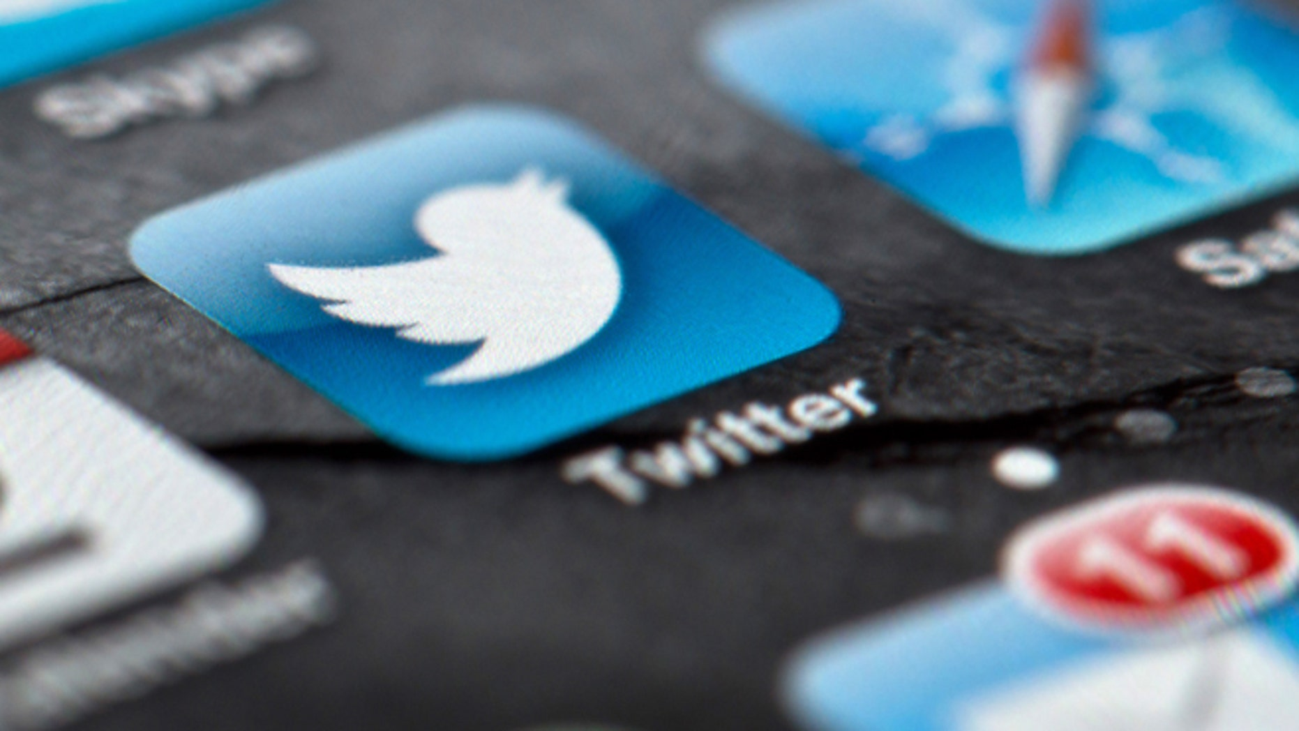 FILE - In this Feb. 2, 2013, file photo, a smartphone display shows the Twitter logo in Berlin, Germany, Twitter unsealed the documents Thursday, Oct. 3, 2013, for its planned initial public offering of stock and says it hopes to raise up to $1 billion. (AP Photo/dpa, Soeren Stache, File)