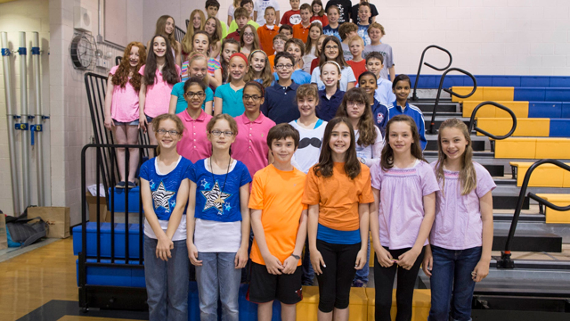 June 6, 2013: Twenty-four sets of twins who are fifth-graders at Highcrest Middle School in Wilmette, Ill.