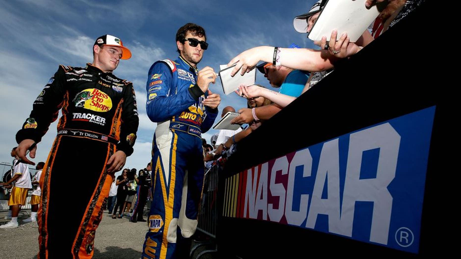 NEWTON, IA - AUGUST 01: Chase Elliott, driver of the #9 NAPA Auto Parts Chevrolet, and Ty Dillon, driver of the #3 Bass Pro Shops/Tracker Boats Chevrolet, sign autographs prior to the start of the NASCAR XFINITY Series U.S. Cellular 250 at Iowa Speedway on August 1, 2015 in Newton, Iowa. (Photo by Sean Gardner/NASCAR via Getty Images)