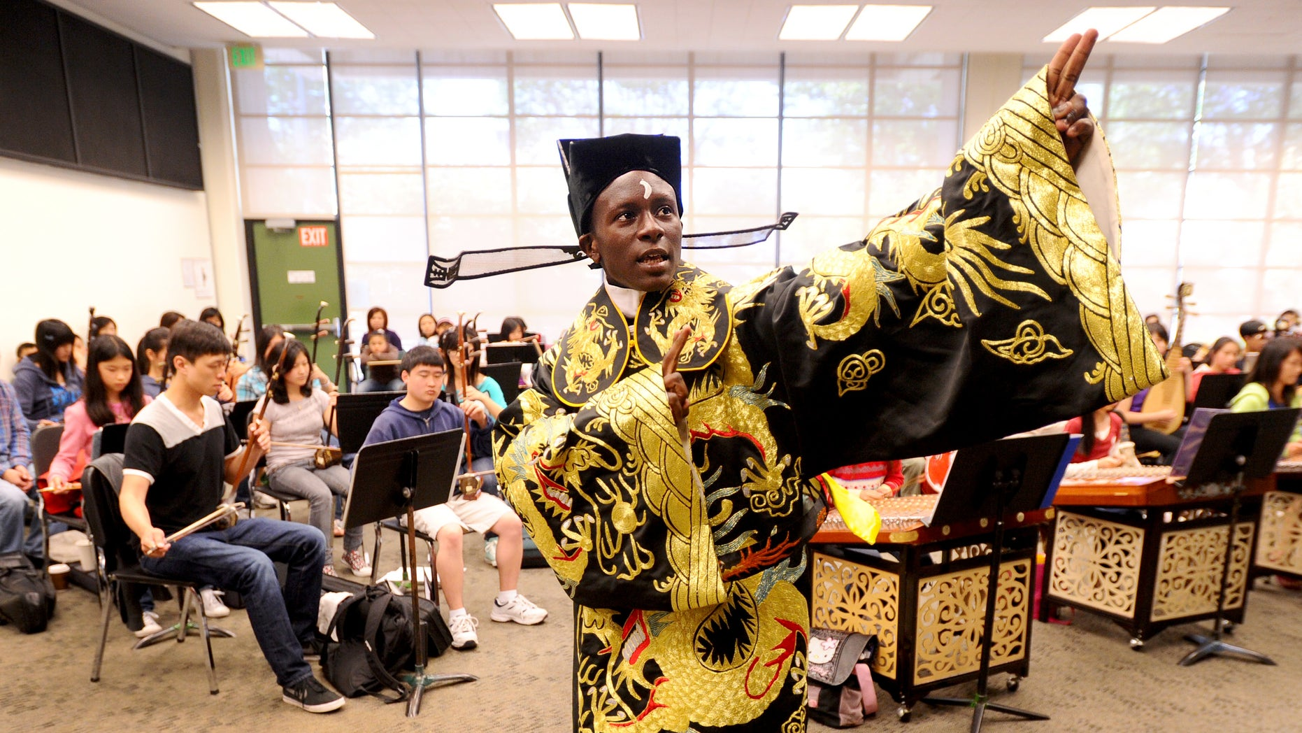 June 11: Tyler Thompson rehearses with the Great Wall Youth Orchestra in Oakland, California. The 15-year-old Oakland native, who sings traditional Chinese opera in Mandarin, plans to perform in China this summer.