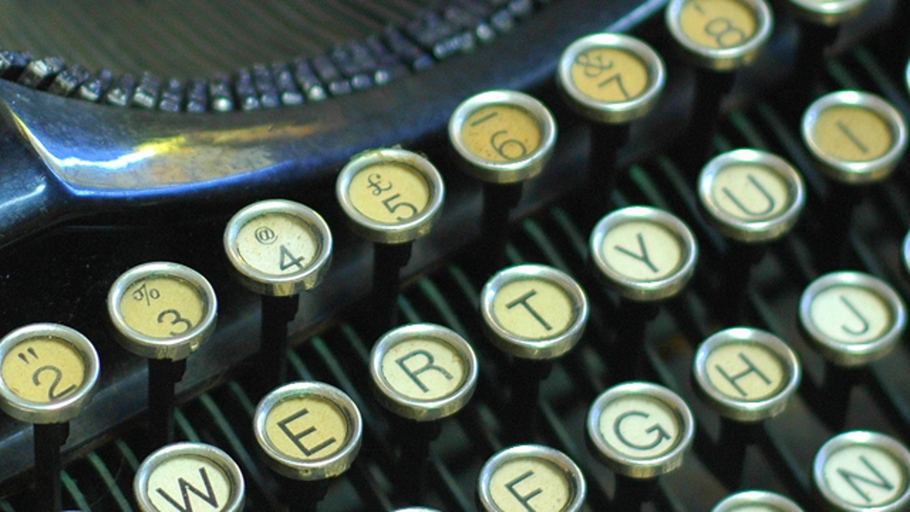 A close up photo of the keys on a vintage Underwood portable typewriter.