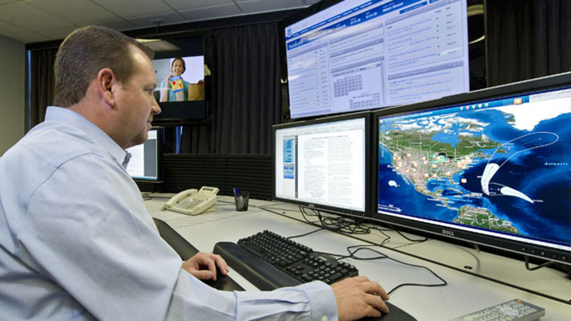 "Sept. 29, 2011: A cyber security analyst works in the ""watch and warning center"" during the first tour of the government's secretive cyber defense lab."