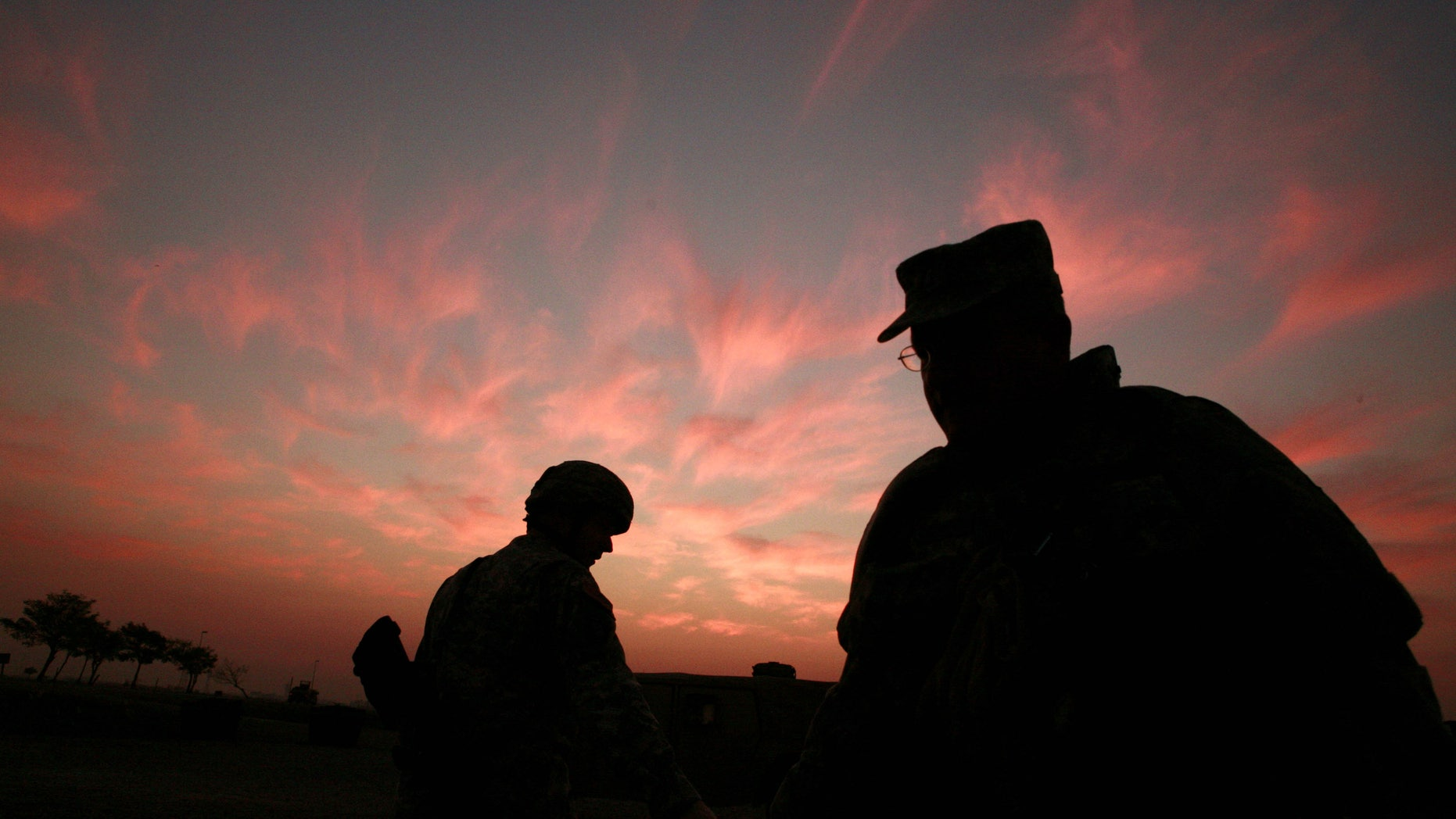 In this Jan. 25, 2007 file photo, the sun sets at a US military base Camp Liberty in Baghdad, Iraq.