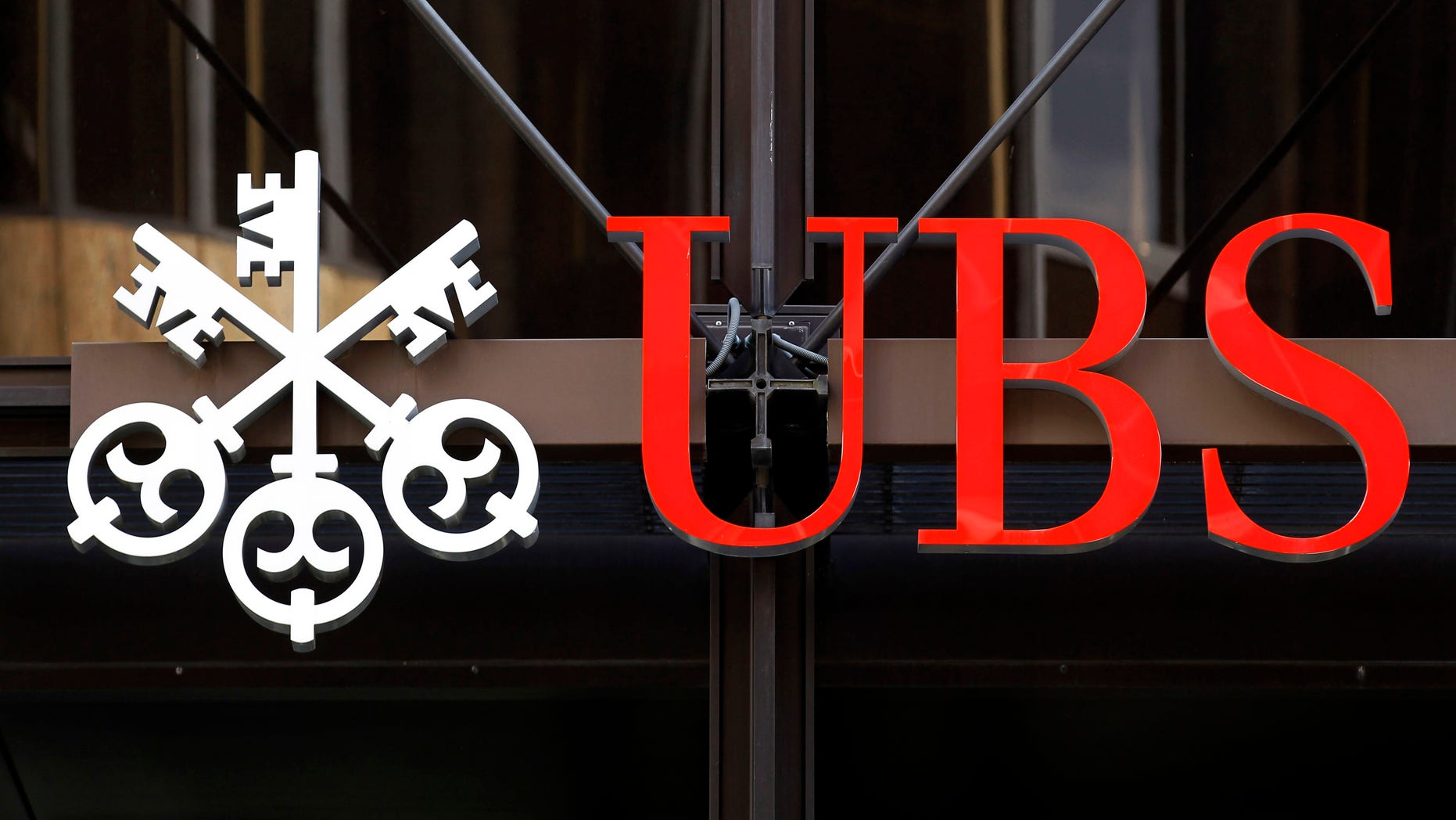 A logo for Swiss bank UBS is seen outside one of their offices in the City of London, Thursday, Sept. 15, 2011. Swiss banking giant UBS said Thursday that a rogue trader has caused it an estimated loss of $2 billion, stunning a beleaguered banking industry that has proven vulnerable to unauthorized trades.