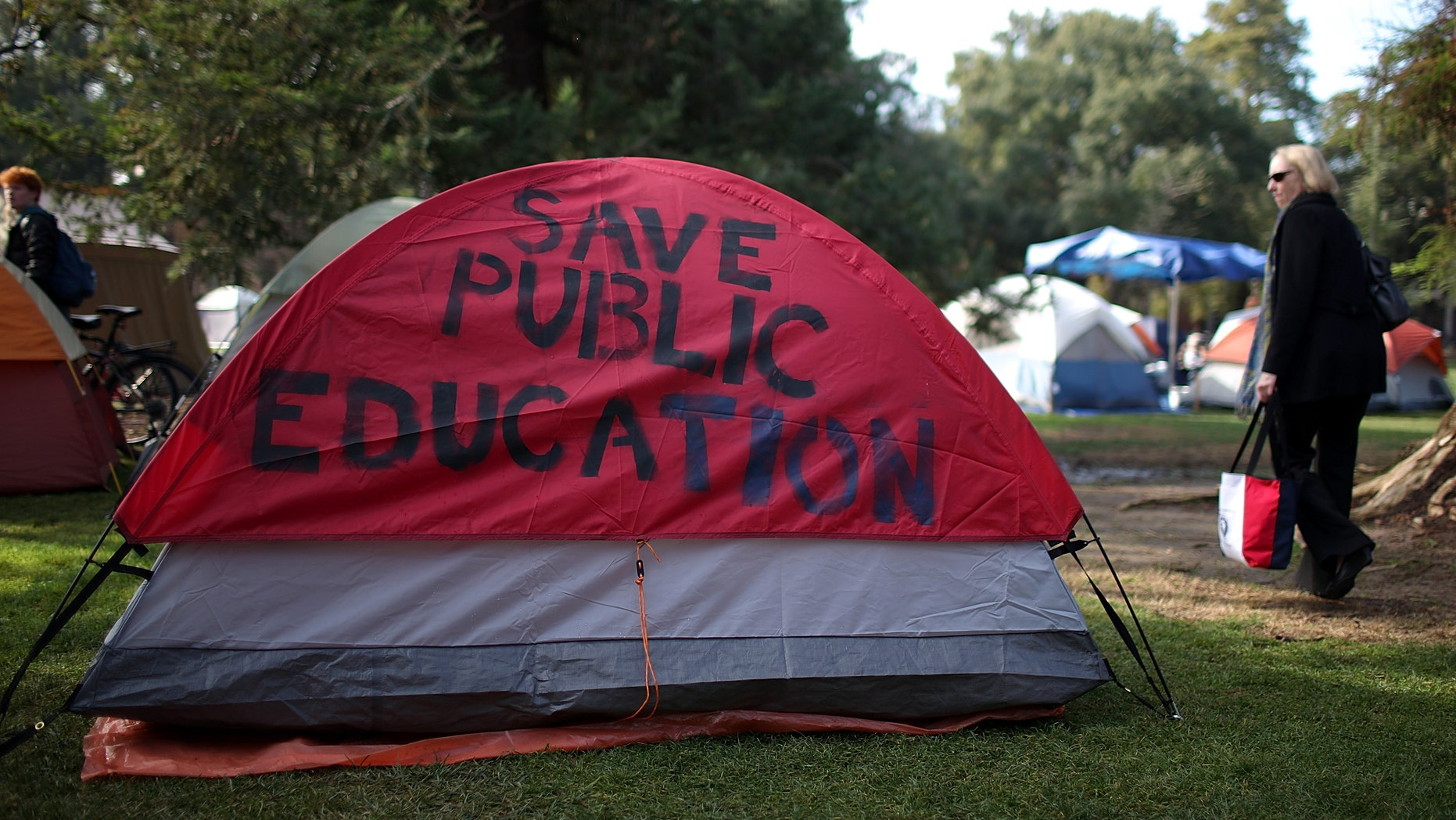 A message is written on the side of a tent at the Occupy UC Davis encampment on November 28, 2011 in Davis, California. (Photo by Justin Sullivan/Getty Images)