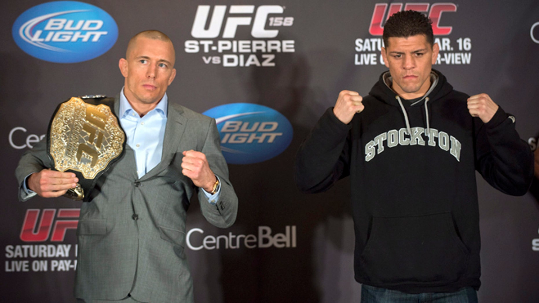 Mixed Martial Arts fighters Georges St-Pierre, left, and Nick Diaz pose for the media following their news conference in Montreal, Thursday, March 14, 2013. The pair will meet in a UFC 158 title fight in Montreal on Saturday. (AP Photo/The Canadian Press, Graham Hughes)
