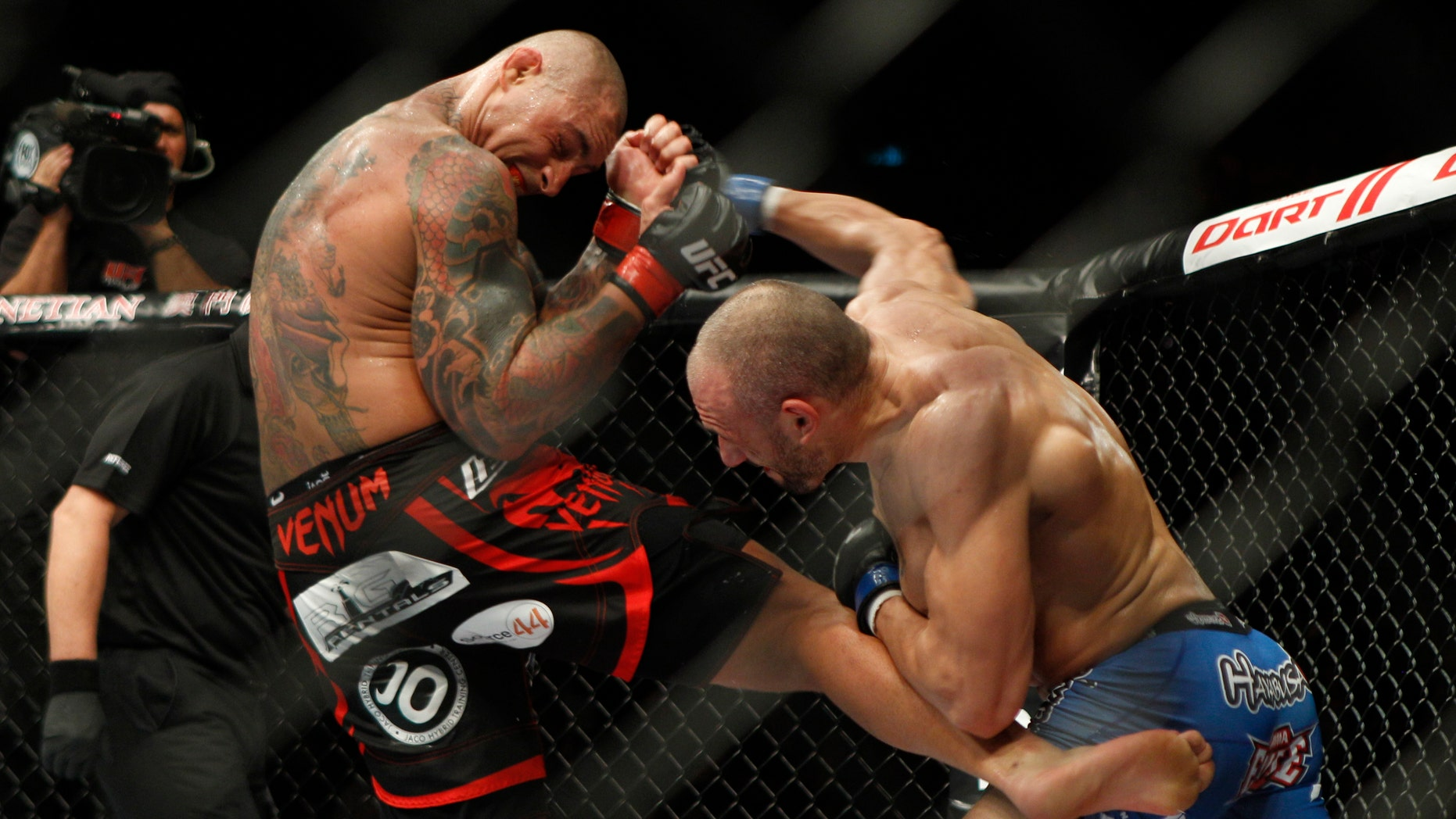 Nov. 10, 2012: In a file photo, Thiago Silva of Boca Raton, Fla., left, fights with Stanislav Nedkov of Bulgaria during the Light Heavyweight match of the Ultimate Fighting Championship UFC  in Macau.