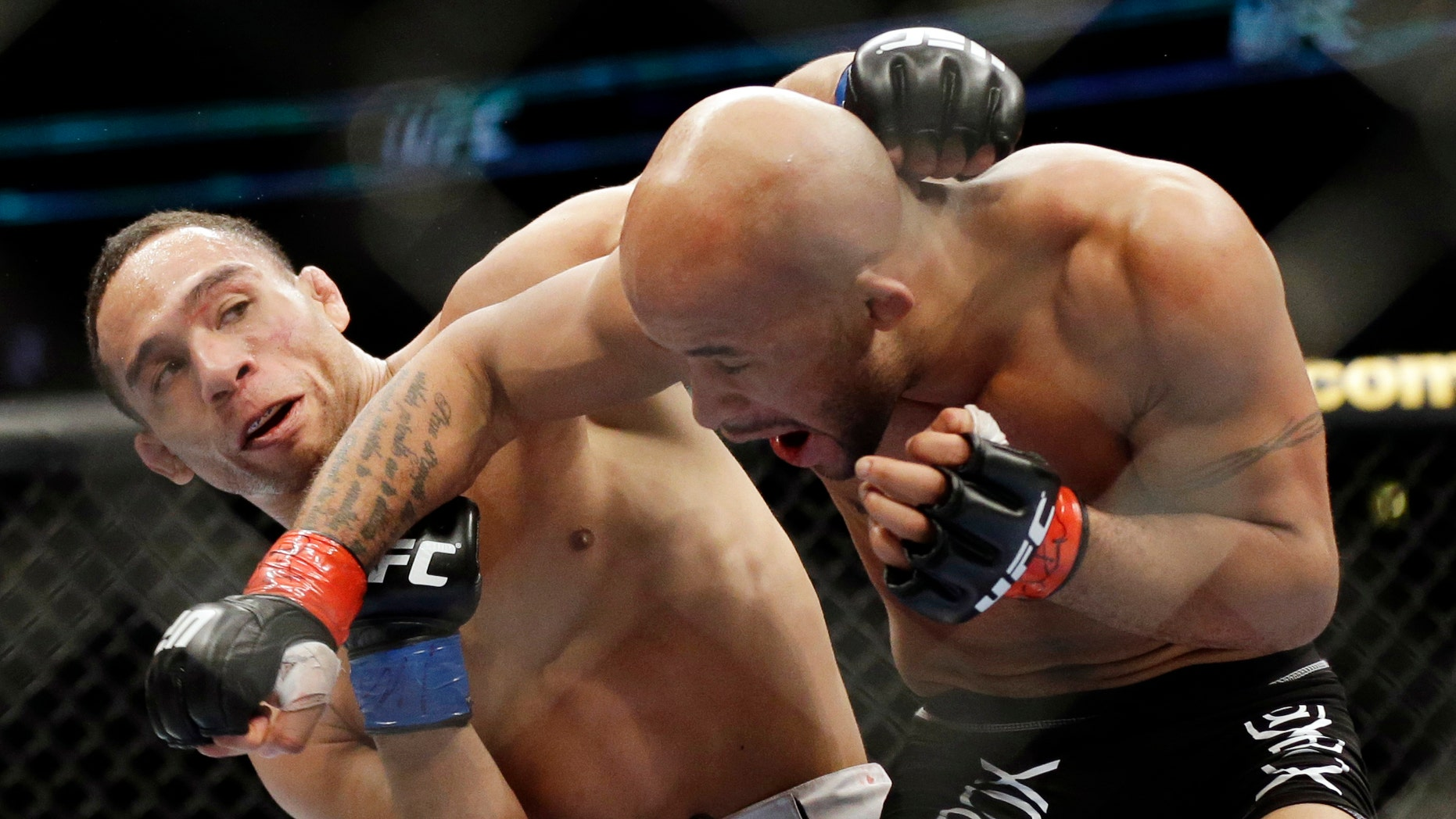 John Dodson, left, fights Demetrious Johnson during the UFC flyweight championship on FOX 6 at United Center in Chicago, Saturday, Jan. 26, 2013. (AP Photo/Nam Y. Huh)