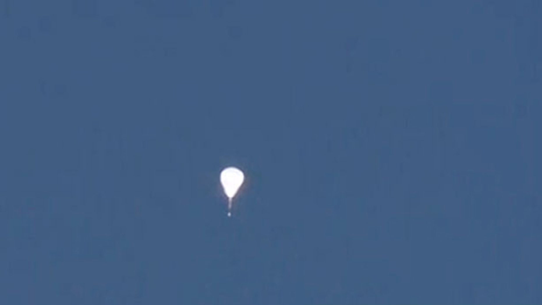 This mysterious, glowing teardrop-shaped object was seen high in the sky above Phoenix.