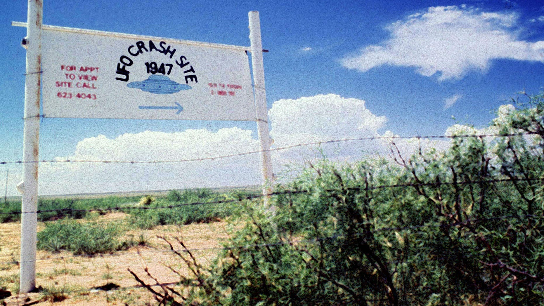 File photo. A sign off route U.S. 285, north of Roswell, New Mexico, points west to the alleged 1947 crash site of a flying saucer on the Corn Ranch.