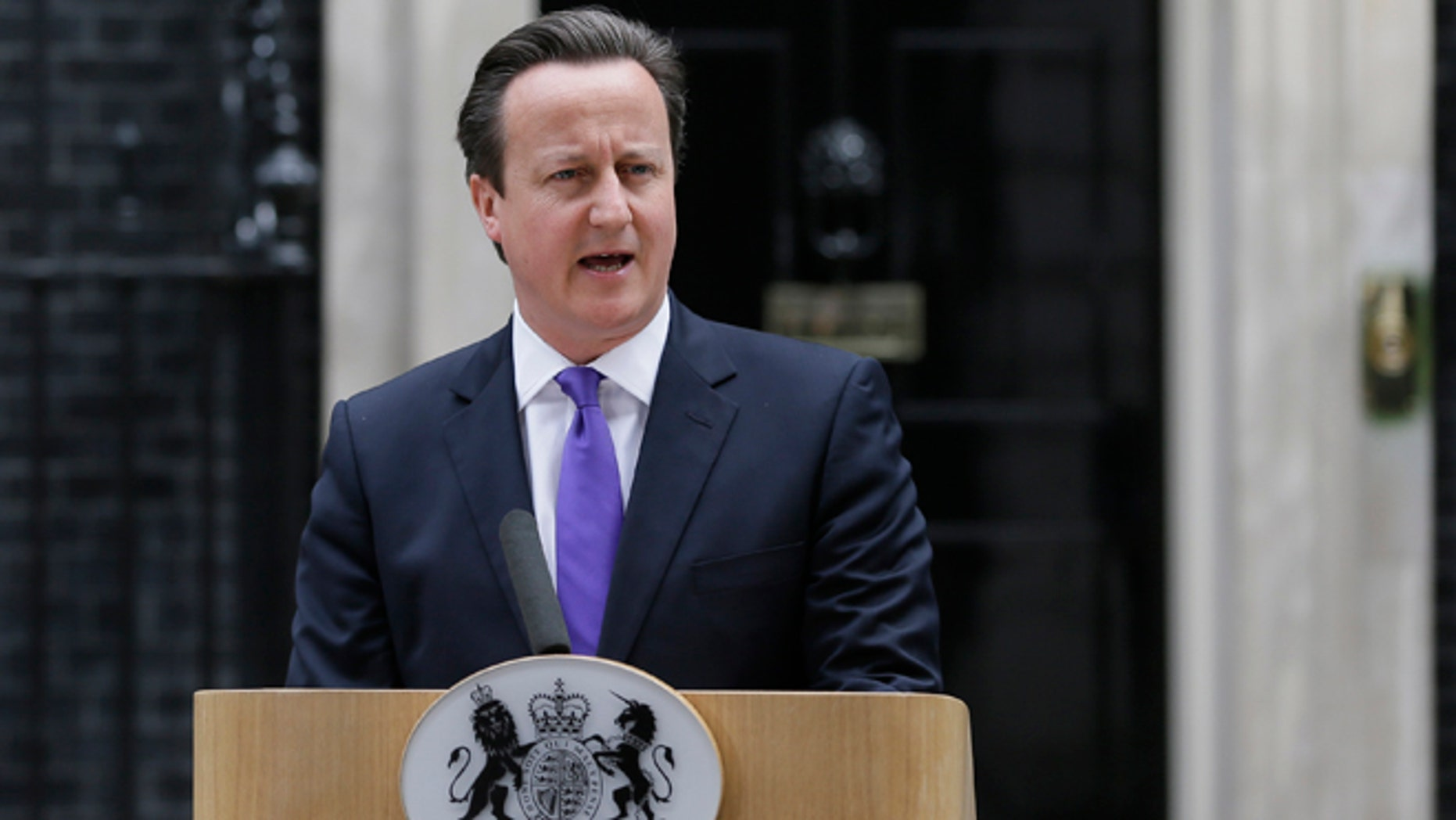 May 23, 2013: Britain's Prime Minister David Cameron speaking to the media outside 10 Downing Street in London. The British government's emergency committee met Thursday after two attackers butchered a British soldier in a daylight attack in London that raised fears terrorism had returned to the capital.