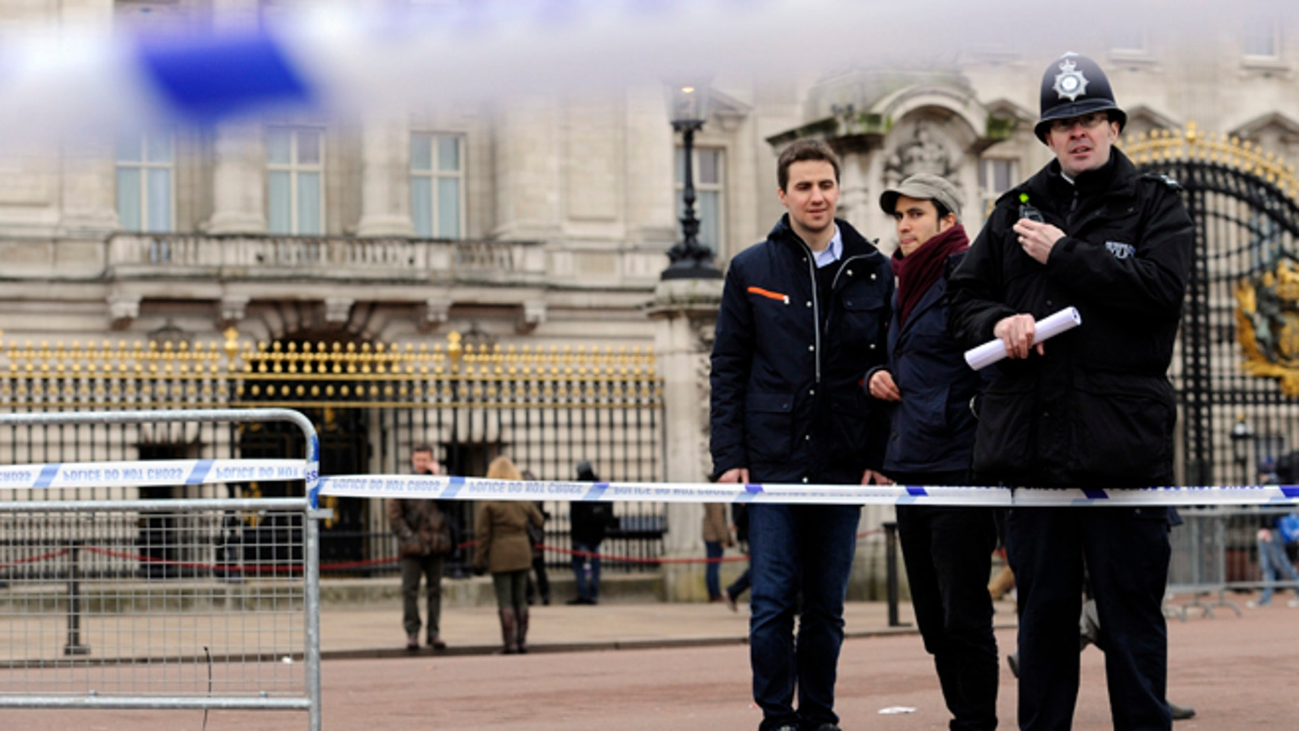 Feb. 3, 2013: A cornered off area containing knives, a hat and Taser wire outside Buckingham Palace in central London after a man armed with two knives was stunned by police.