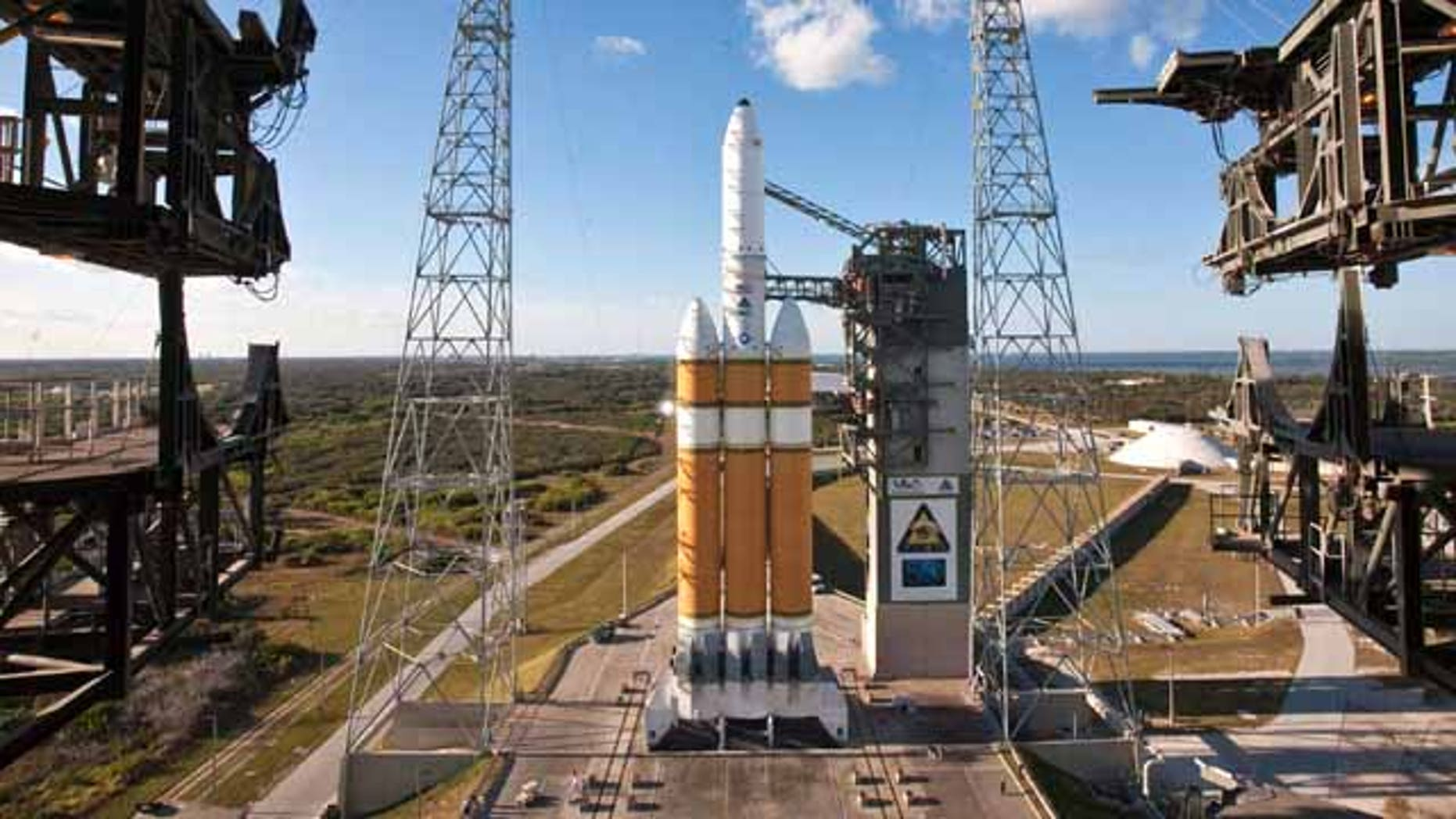 A United Launch Alliance Delta IV Heavy sits poised on its launch pad with a National Reconnaissance Office payload at Space Launch Complex-37. The Delta IV Heavy with its nearly 2 millions pounds of thrust is America's most powerful liquid-fueled rocket.