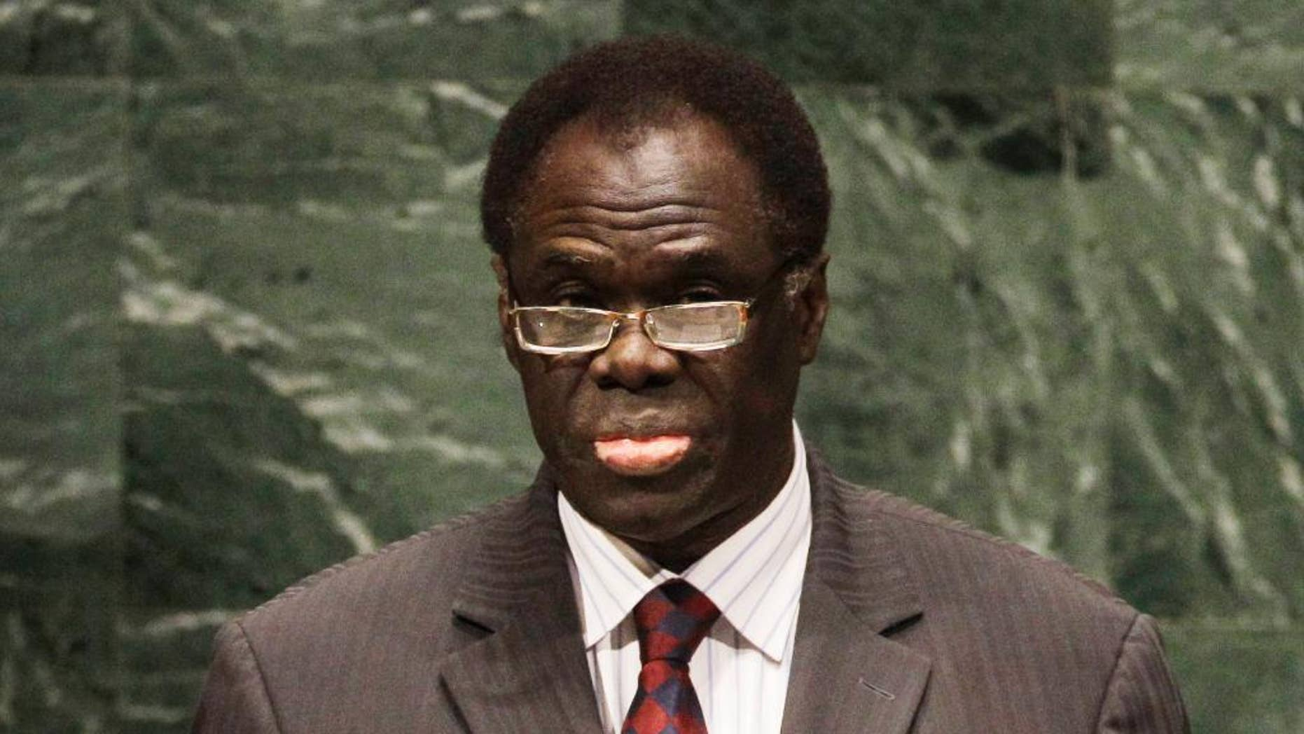 In this Tuesday, Sept. 28, 2010, photo Michel Kafando, Chairman of the Delegation of Burkina Faso addresses the 65th session of the United Nations General Assembly at U.N. headquarters in New York. Burkina Faso's former ambassador to the United Nations is slated to be in charge of a civilian transitional government after the military briefly seized control of the country last month. Michel Kafando, 72, was named early Monday, Nov. 17, 2014, as transitional president to lead Burkina Faso until elections a year from now. (AP Photo/Frank Franklin II)