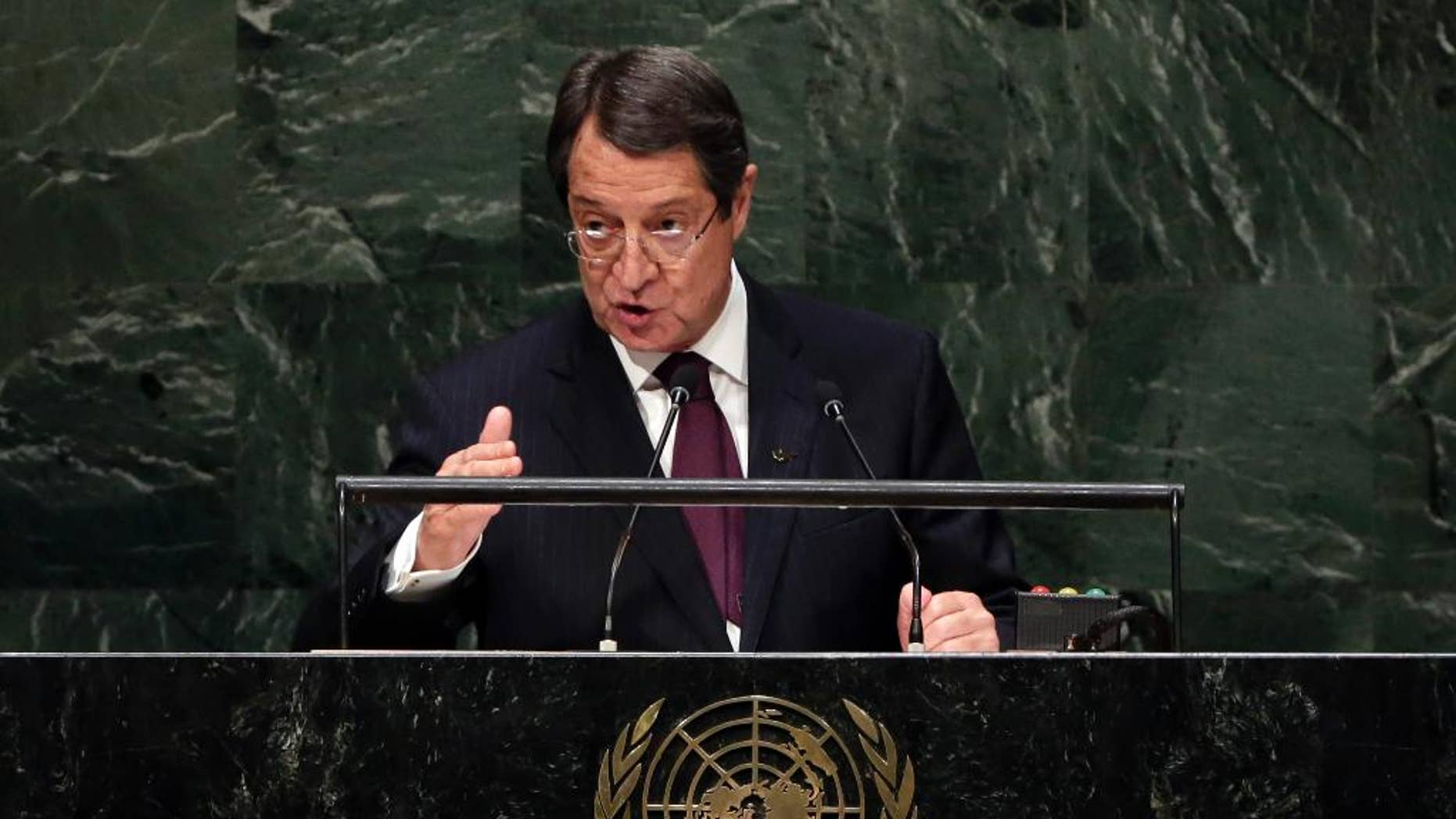 FILE - A Friday, Sept. 26, 2014 photo from files showing President Nicos Anastasiades, of Cyprus, addressing the 69th session of the United Nations General Assembly, at U.N. headquarters. The president of Cyprus was admitted to a hospital in Brussels after a prolonged nosebleed that doctors said was caused by hypertension, an official said Thursday, Oct. 23, 2014. Cyprus government spokesman Nicos Christodoulides said President Nicos Anastasiades received treatment and will rest for two days on the advice of doctors to avoid a recurrence of the nosebleed. (AP Photo/Richard Drew)