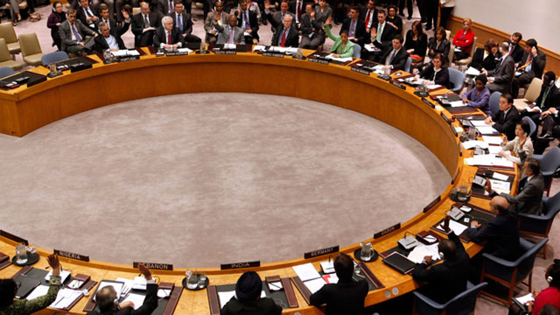 Member states vote to approve a resolution that will impose a no-fly zone over Libya during a meeting of the United Nations Security Council at UN headquarters Thursday, March 17, 2011. (AP)