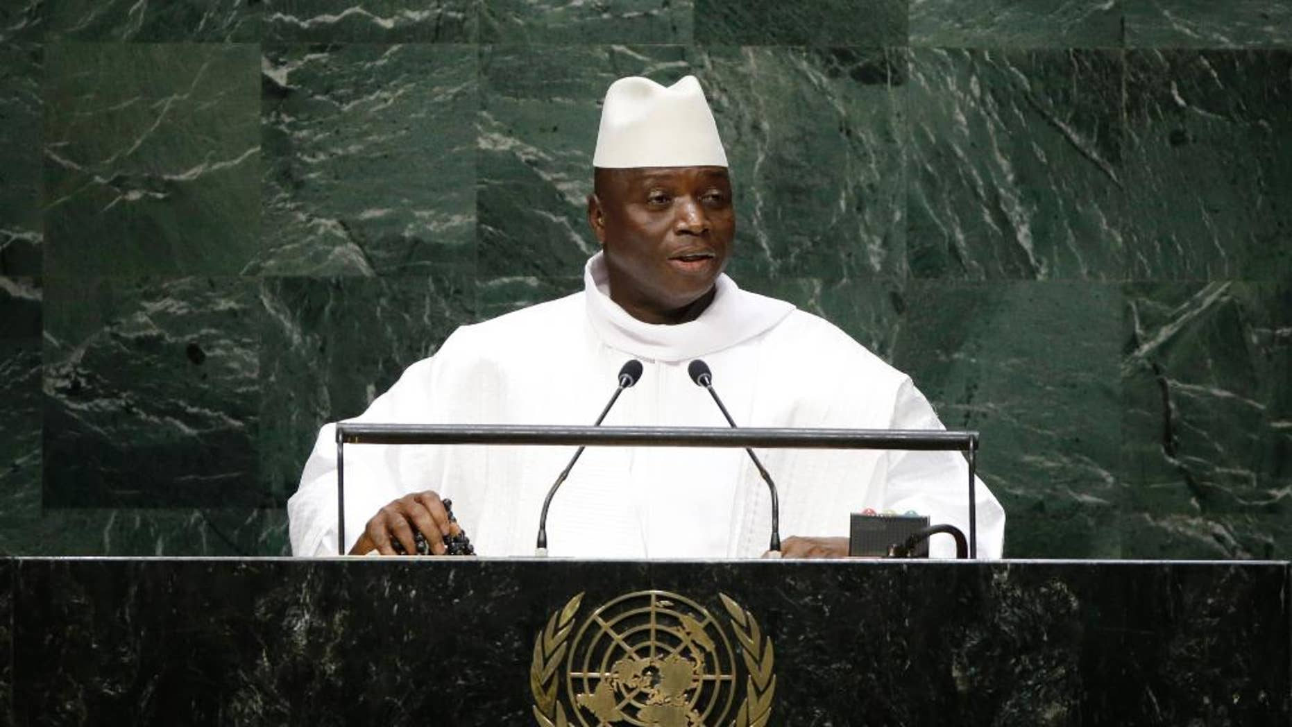 """FILE - In this Thursday, Sept. 25, 2014, file photo, Gambia's President Al Hadji Yahya Jammeh addresses the 69th session of the United Nations General Assembly at the United Nations headquarters. Gambia accused European countries of """"racist and inhuman behavior"""" for deliberately causing boats carrying black African migrants to sink. (AP Photo/Frank Franklin II, File)"""