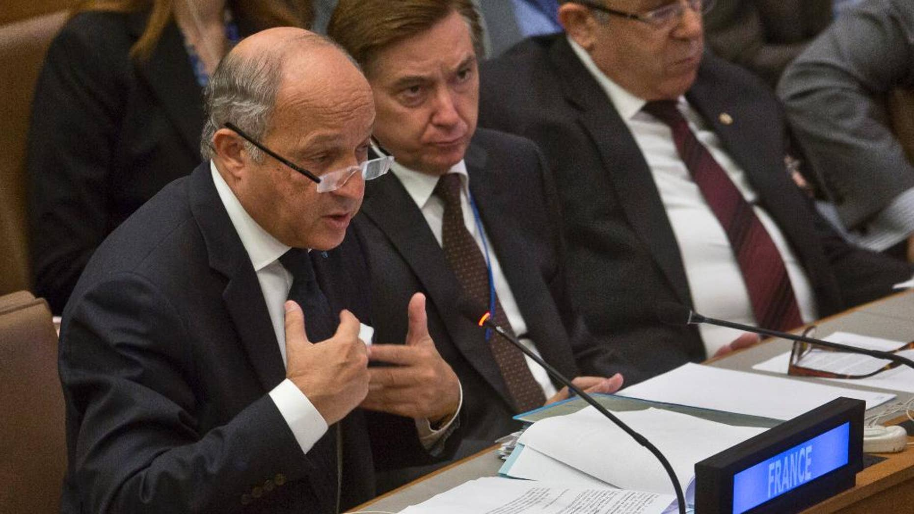 French Foreign Minister Laurent Fabius speaks during a high level meeting on Libya Thursday, Sept. 25, 2014, during the 69th session of the U.N. General Assembly meetings at the United Nations headquarters.  (AP Photo/Bebeto Matthews)