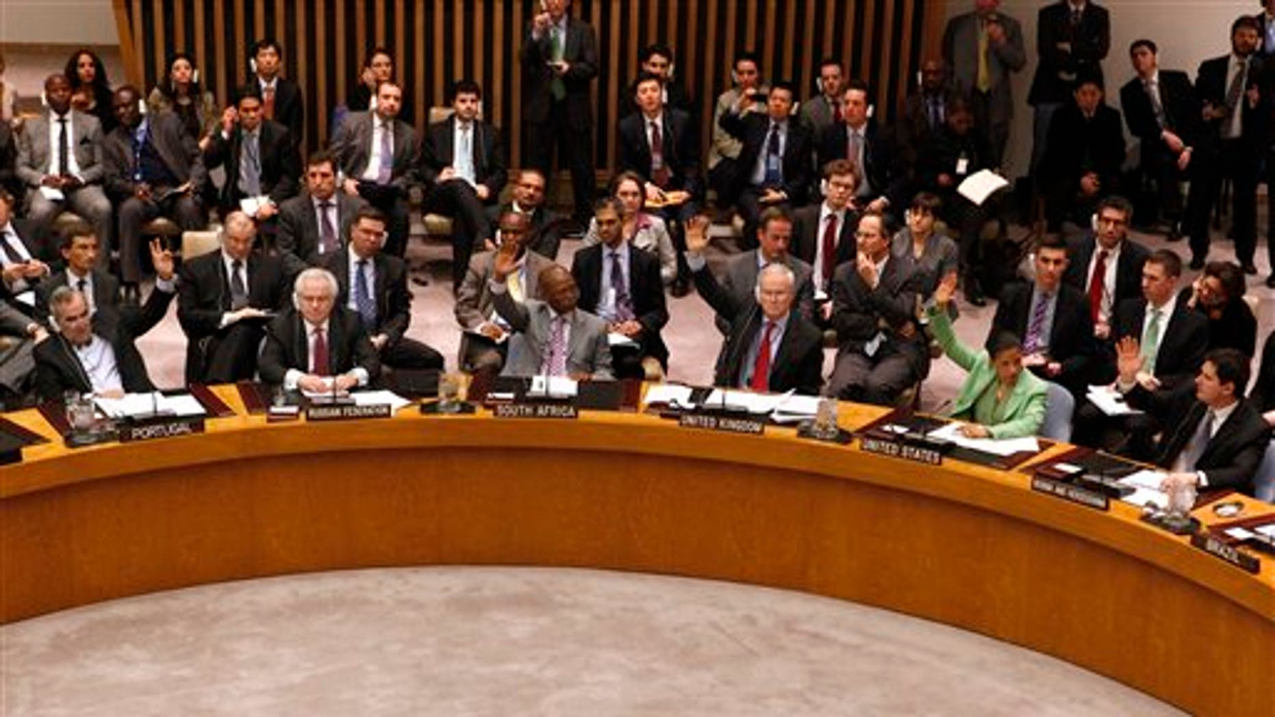 """March 17: Russia, second left, abstains as member states vote to approve a resolution that will impose a no-fly zone over Libya during a meeting of the United Nations Security Council at UN headquarters.  In addition to the no-fly zone, the resolution authorizes """"all necessary measures"""" to protect civilians from attacks by Muammar Qaddafi's forces. (AP)"""