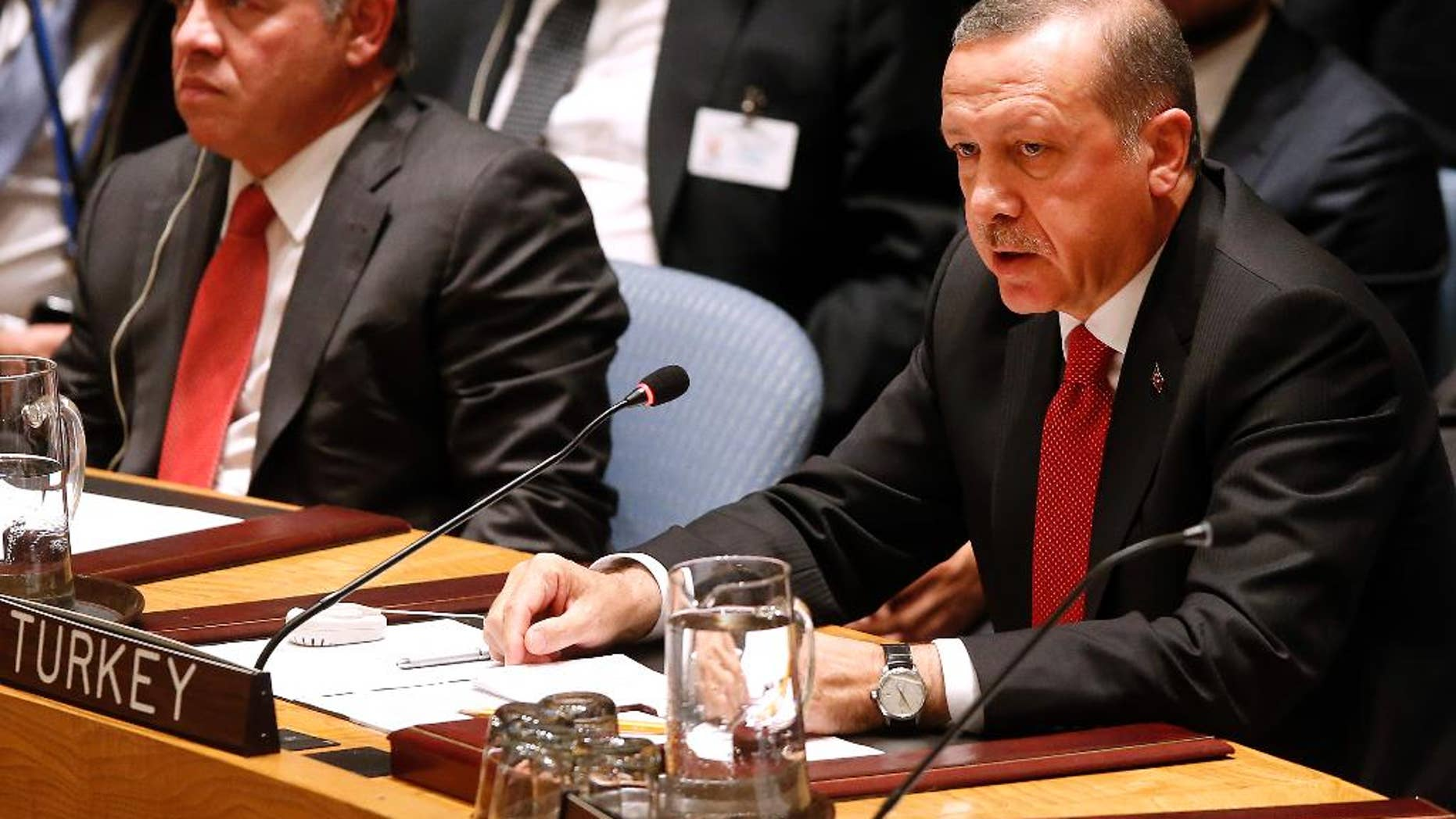 President Recep Tayyib Erdogan of Turkey addresses a meeting of the United Nations Security Council regarding the threat of foreign terrorist fighters during the 69th session of the U.N. General Assembly at U.N. headquarters, Wednesday, Sept. 24, 2014. (AP Photo/Jason DeCrow)