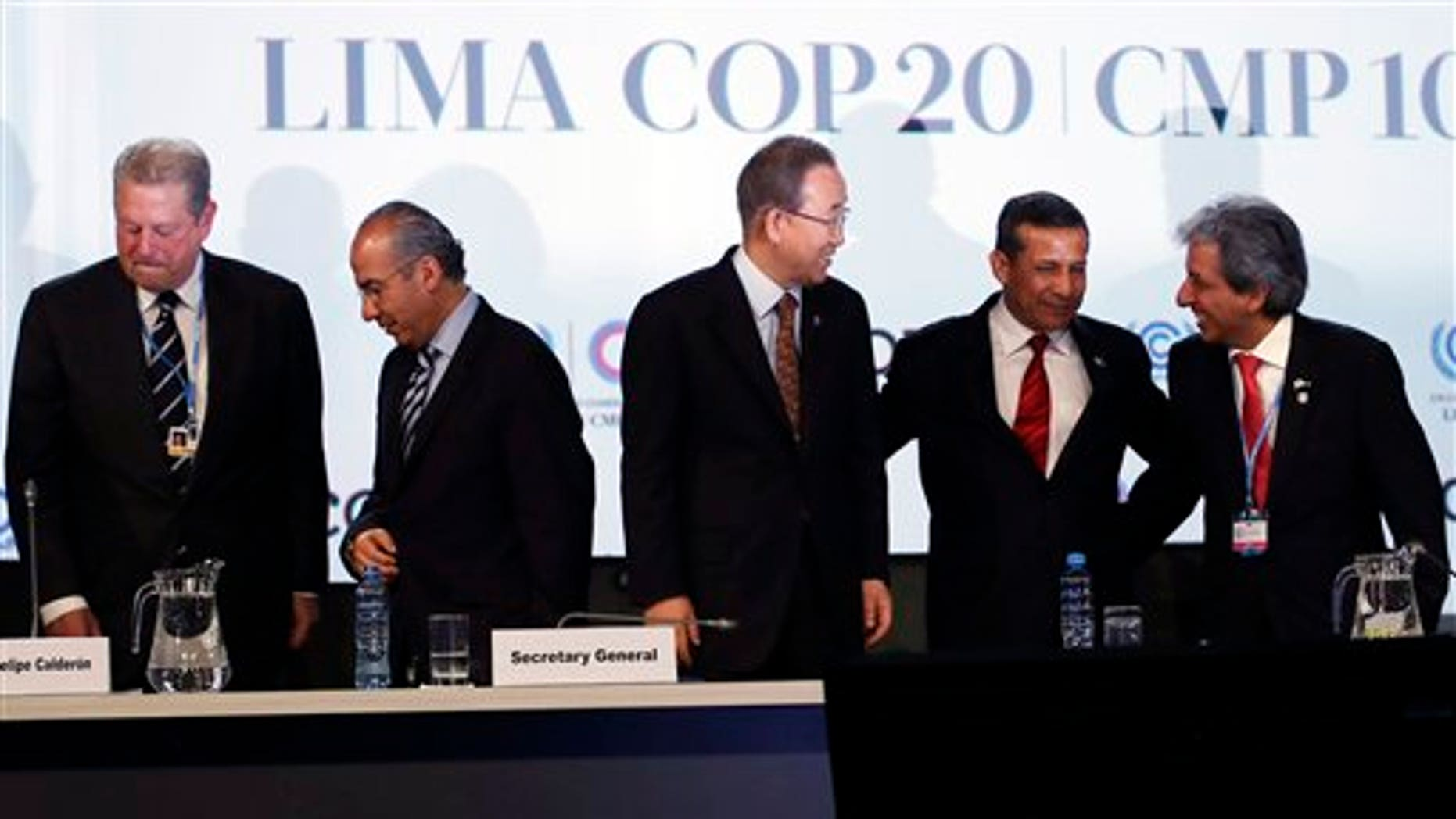 Attendees at the UN Climate Change Conference in Lima, Peru, on Thursday, Dec. 11, 2014, included, from left: Former Vice President of the United States Al Gore; Former President of Mexico Felipe Calderon; UN Secretary General Ban Ki-moon; Peru's President Ollanta Humala and Peru's Environment Minister and President of the COP, Manuel Pulgar Vidal.. (AP Photo/Juan Karita)