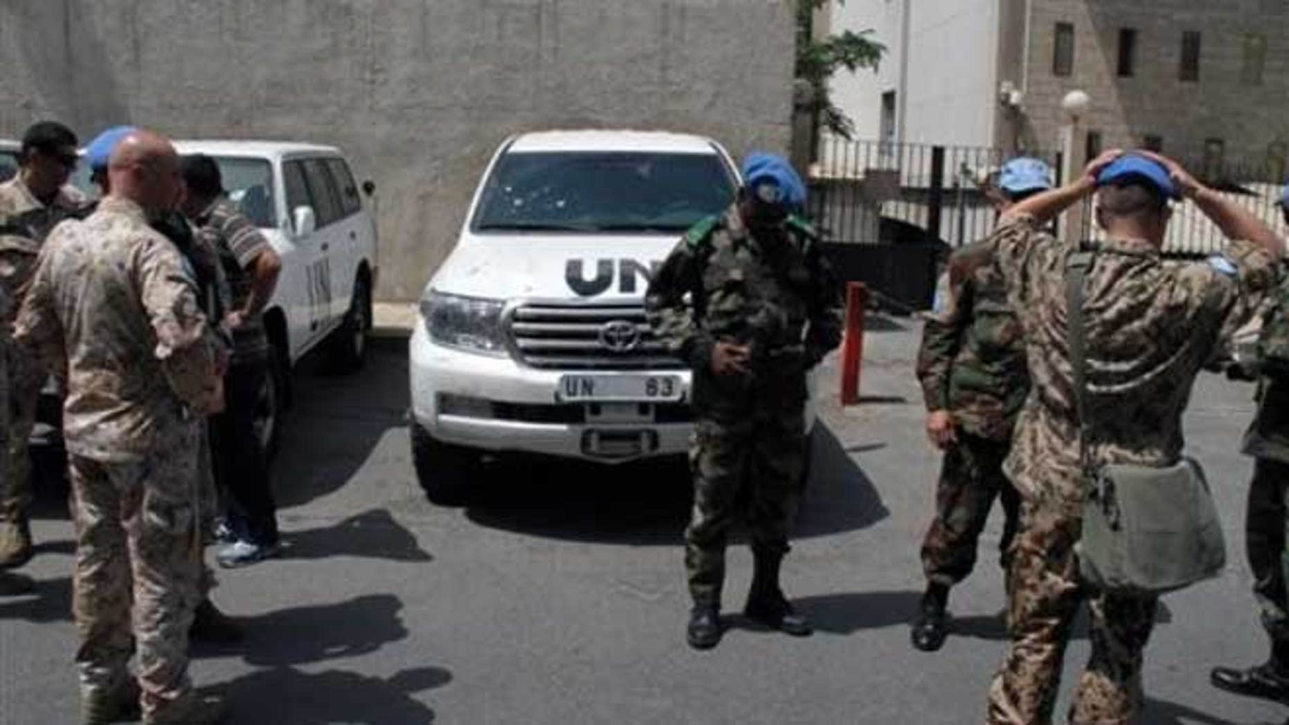 June 16, 2012: U.N. observers welcome their comrades upon their return from al-Haffa, in northern Syria.