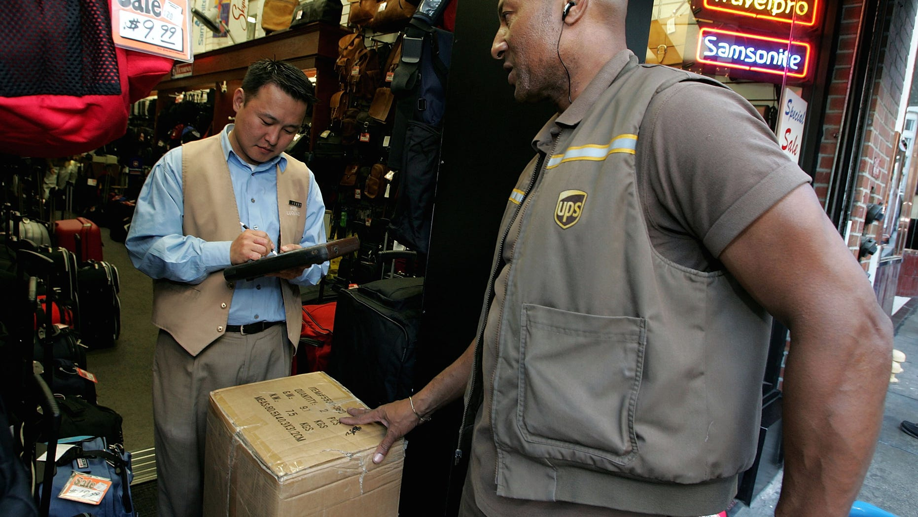 SAN FRANCISCO - DECEMBER 17: UPS driver Doug Lamb delivers a package to a store December 17, 2004 in San Francisco, California. UPS expects to deliver more than 20 million packages on Dec. 21, its busiest shipping day of the year. (Photo by Justin Sullivan/Getty Images)