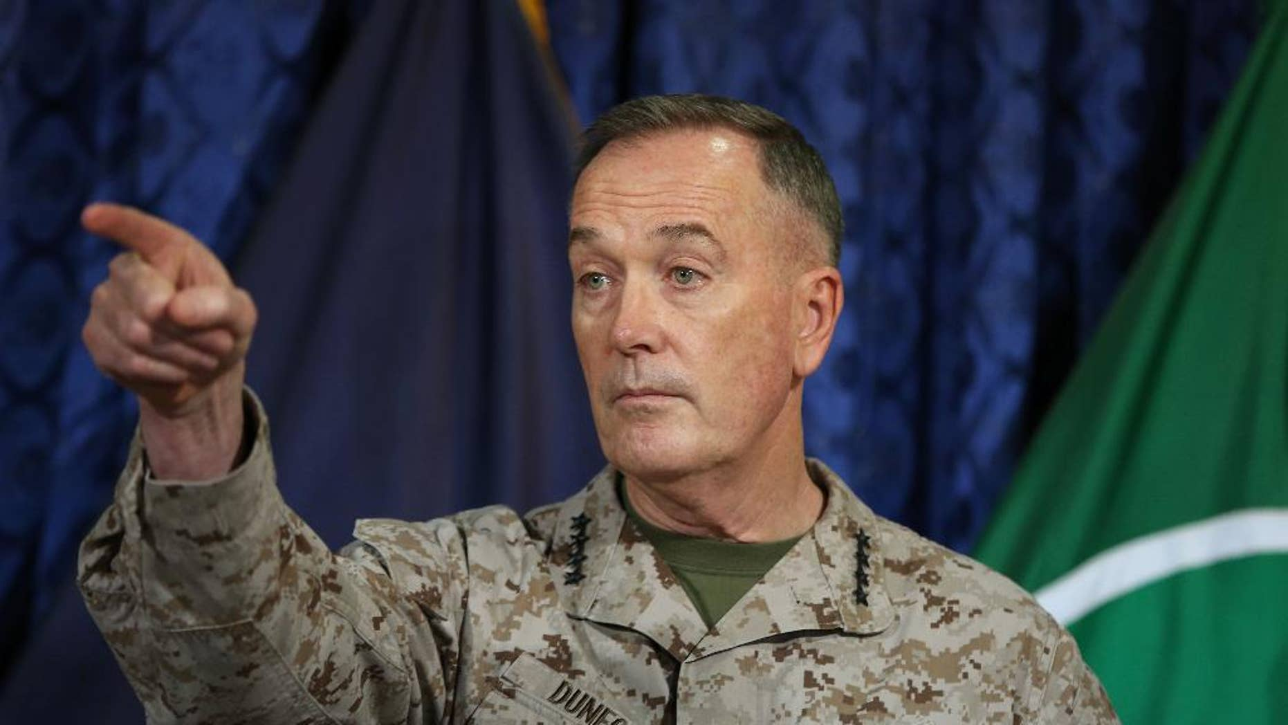 FILE - In this May 28, 2014, file photo, Gen. Joseph Dunford, points during a news conference at the ISAF Headquarters in Kabul, Afghanistan. The top U.S. military commander in Afghanistan said the U.S. has increased its surveillance over the Afghan-Pakistani border, as Pakistan pounds a militant stronghold with airstrikes. (AP Photo/Massoud Hossaini, File)