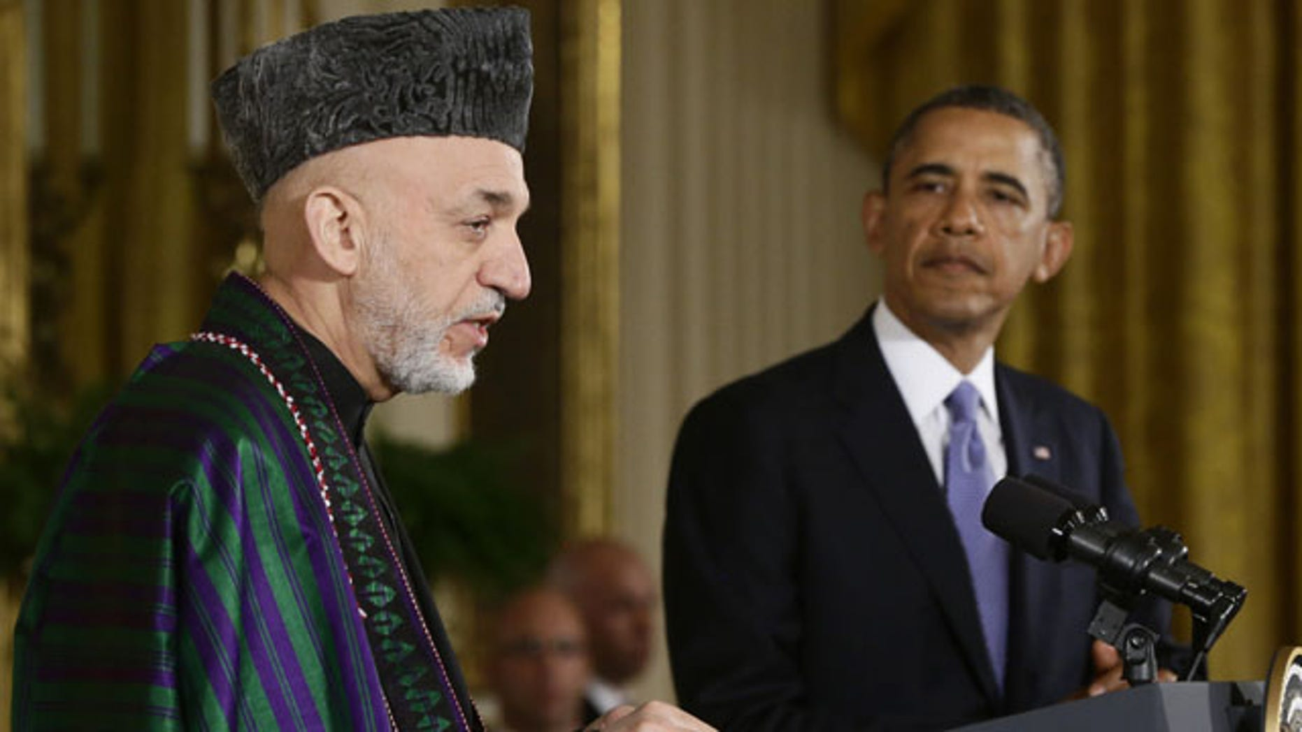 FILE - This Jan. 11, 2013 file photo shows President Barack Obama listening as Afghan President Hamid Karzai speaks during a news conference in the East Room at the White House in Washington. (AP)