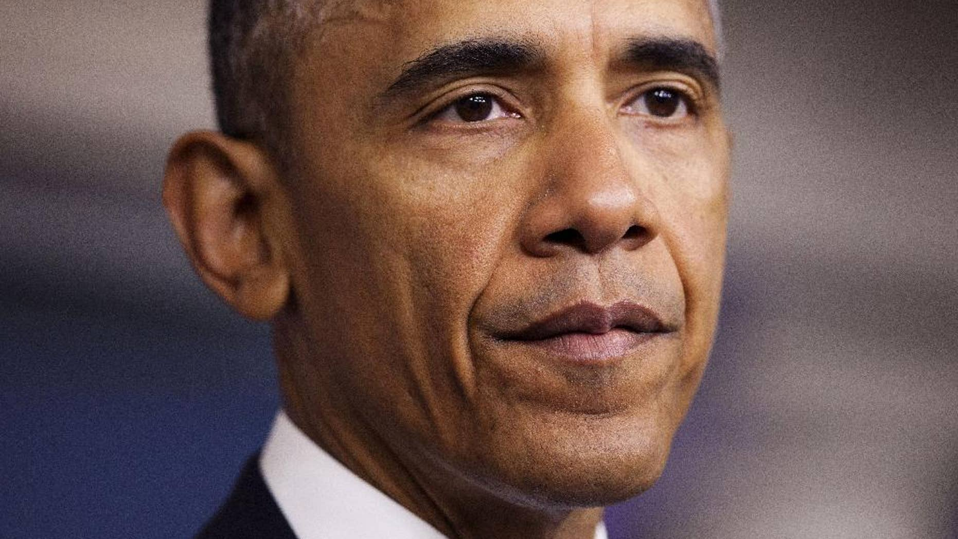 FILE - In this April 23, 2015 file photo, President Barack Obama pauses while speaking in the Brady Press Briefing Room of the White House in Washington, where he took full responsibility for deaths of American, Italian hostages, expresses apologies. The accidental killing of two hostages in a U.S. counterterrorism operation against al-Qaida has raised pressure on the White House to revise the nation's oft-criticized strategy for dealing with abducted Americans. A day after President Barack Obama apologized and took responsibility for the deaths of American Warren Weinstein and Italian Giovanni Lo Porto, administration officials said Friday that a nearly yearlong, interagency review of the policy is to be completed this spring. (AP Photo/Pablo Martinez Monsivais, File)