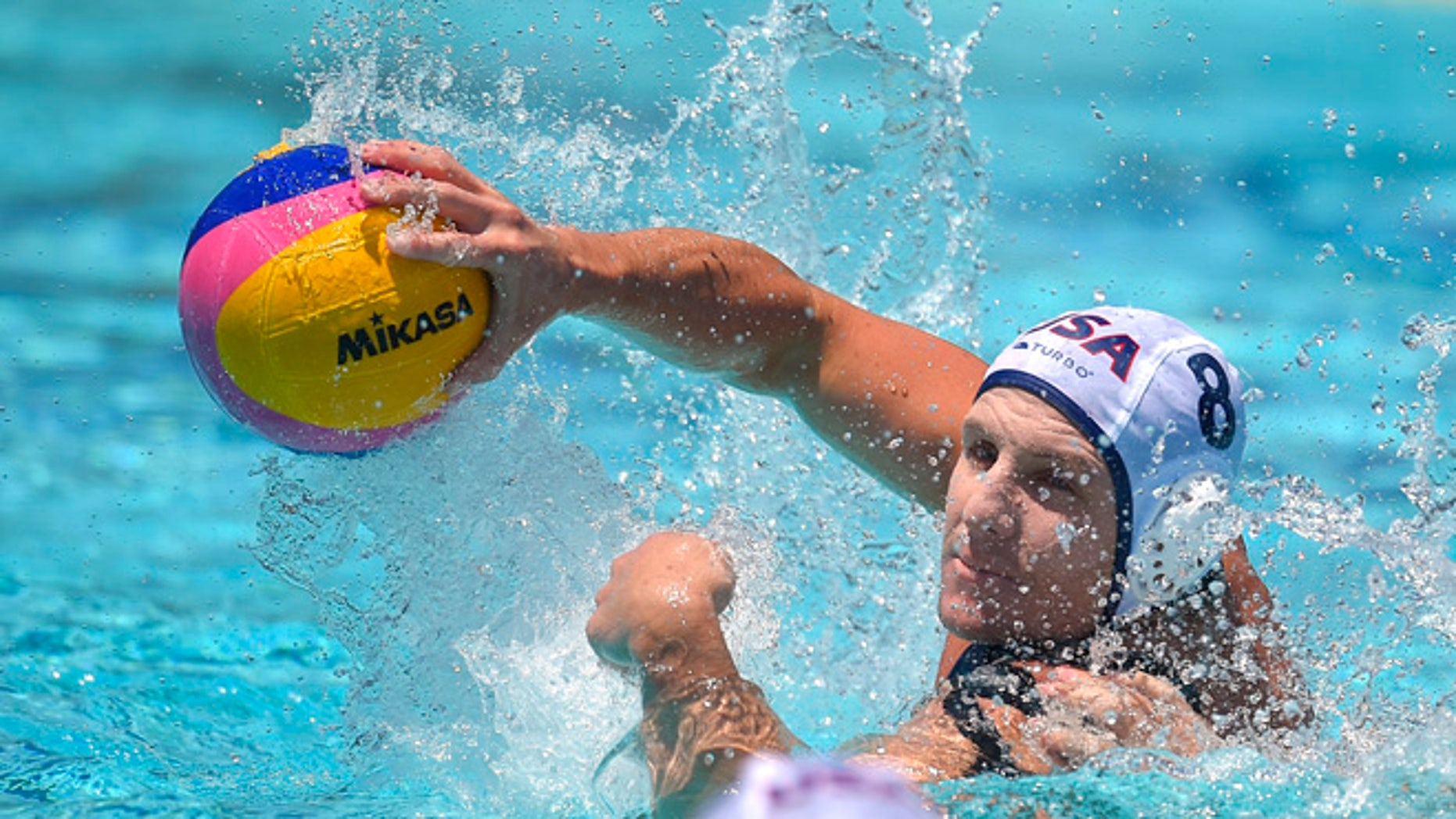 United States attacker Tony Azevedo passes the ball during a men's exhibition water polo match against Australia, Sunday, May 22, 2016, in Los Angeles. (AP Photo/Mark J. Terrill)