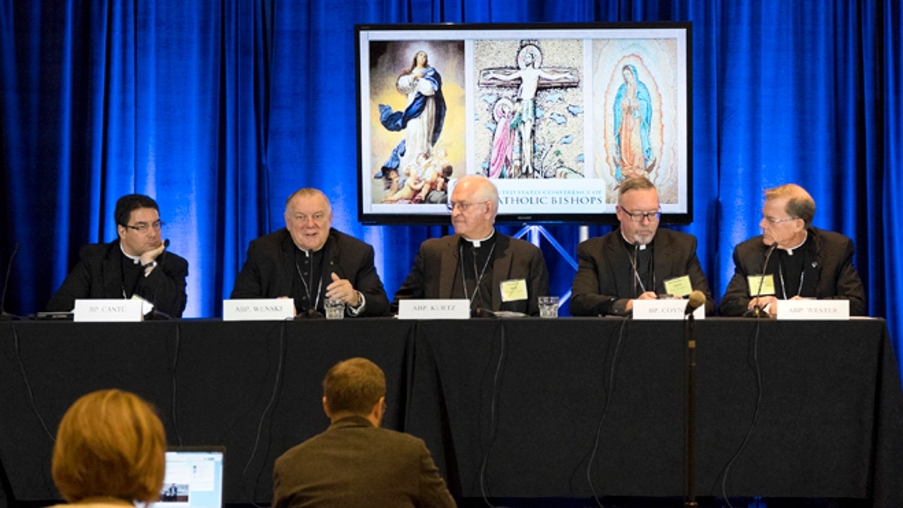 Bishop Oscar Cantú, left, of Las Cruses, Archbishop Thomas Wenski, of Miami, Archbishop Joseph Kurtz, of Louisville and president of the U.S. Conference of Catholic Bishops, Bishop Christopher Coyne, of Burlington and Archbishop John Wester, of Santa Fe, participate in a news conference during the U.S. Conference of Catholic Bishops' Spring General Assembly in St. Louis Wednesday, June 10, 2015.  Roman Catholic bishops are condemning racism in the U.S. in light of national tensions over police treatment of African-Americans. (AP Photo/Sid Hastings)