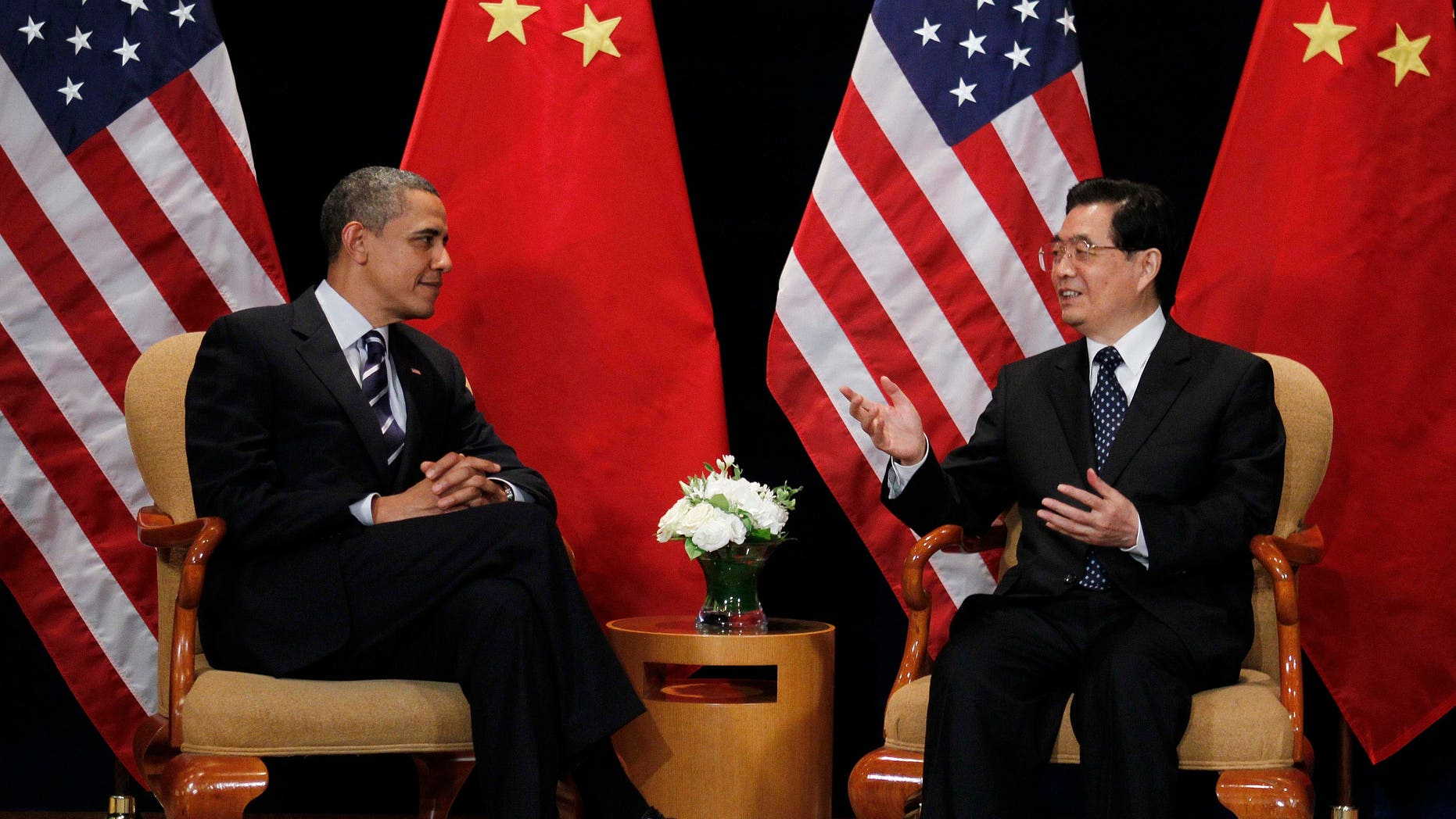 FILE - In this Nov. 11, 2010, file photo President Barack Obama meets with China's President Hu Jintao on the sidelines of the G-20 summit in Seoul, South Korea.