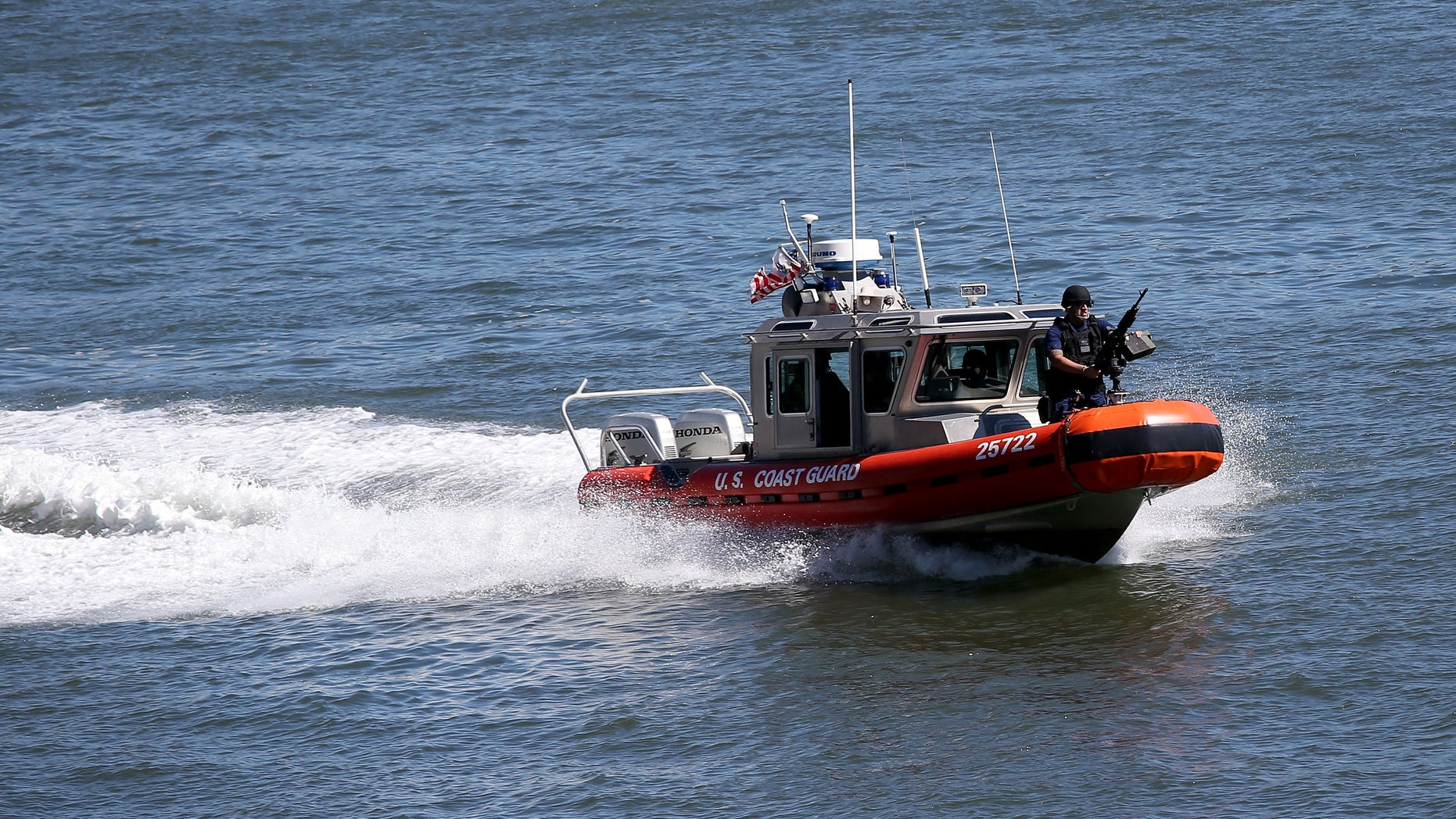 NEW YORK, NY - SEPTEMBER 23:  A U.S. Coast Guard boat patrols the East River near the United Nations building ahead of the 68th session of the General Assembly on September 23, 2013 in New York City. With an influx of foreign dignitaries visiting heavy security and multiple road closures in the city is expected for this week's 68th session of the General Assembly of the United Nations.  (Photo by John Moore/Getty Images)