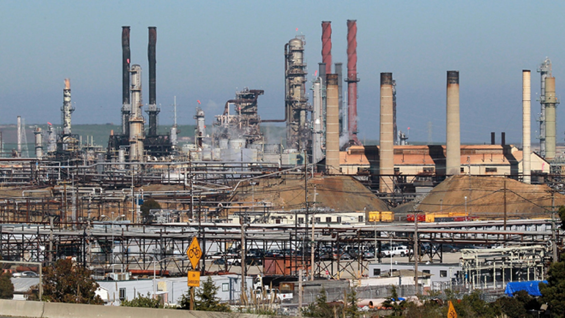 A car drives past the Chevron refinery on January 25, 2011 in Richmond, California. (Photo by Justin Sullivan/Getty Images)