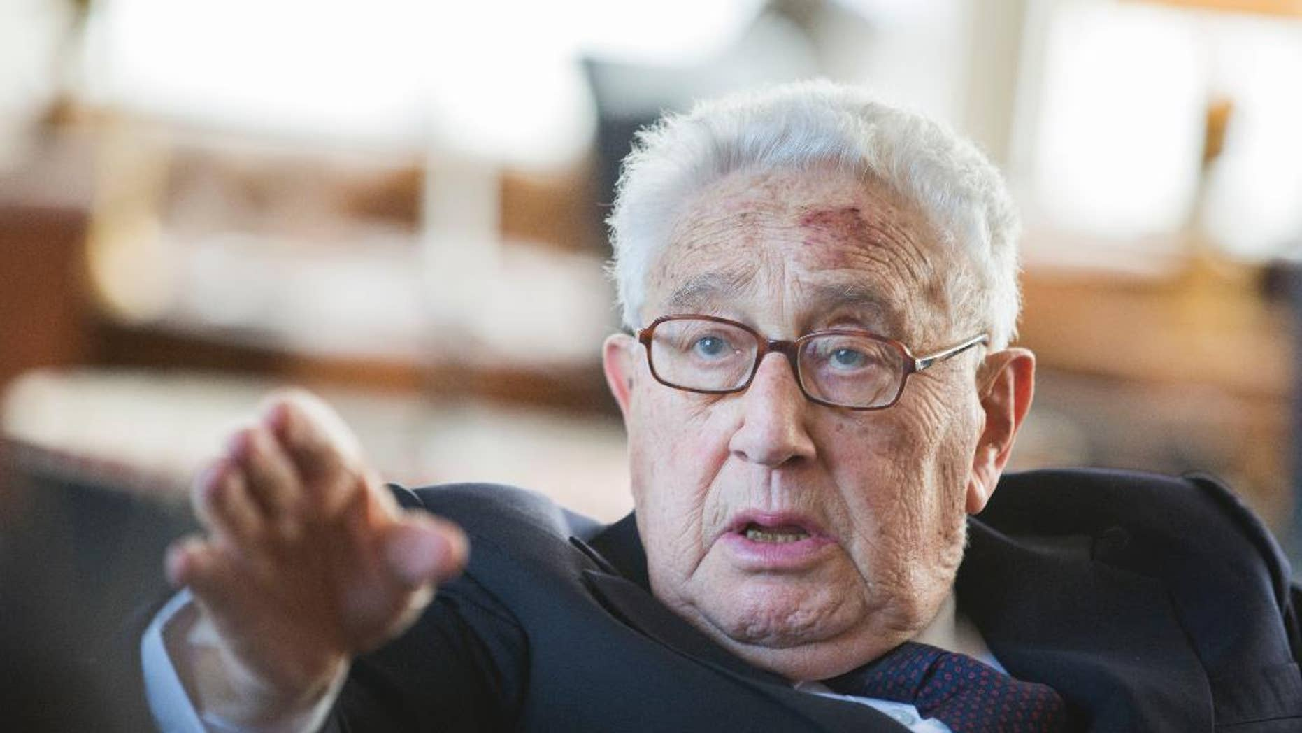 FILE - In a June 11, 2013 file photo, former US Secretary of State Henry Kissinger gestures during a birthday reception for his 90th birthday in Berlin, Germany. According to declassified government documents posted online Wednesday, Oct. 1, 2014, Kissinger ordered contingency plans drawn up nearly 40 years ago to attack Cuba, incensed over the small island's deployment of troops to Angola. (AP Photo/Gero Breloer, Pool)