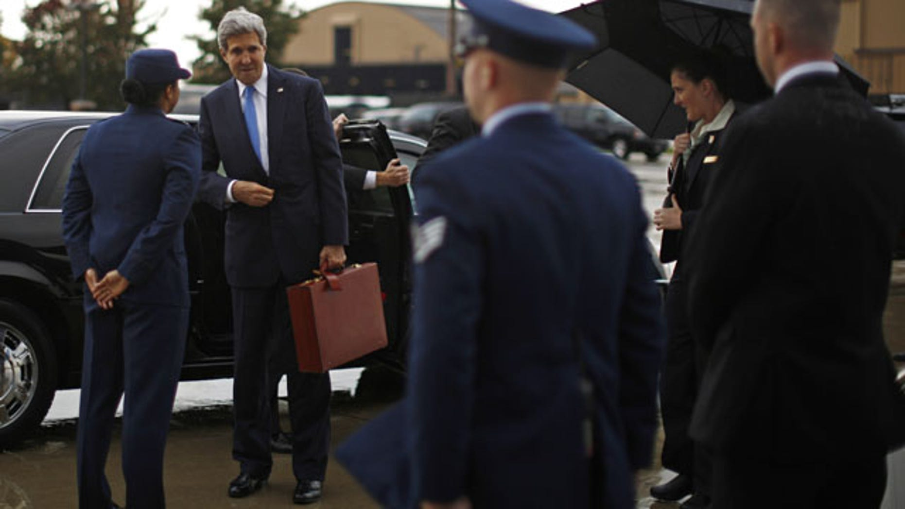 November 2, 1963: U.S. Secretary of State John Kerry prepares to board his aircraft at Andrews Air Force Base near Washington. Kerry is in Cairo pressing for reforms during the highest-level American visit to Egypt since the ouster of the country's first democratically elected president. The Egyptian military's removal of Mohammed Morsi in July led the U.S. to suspend hundreds of millions of dollars in aid. (AP Photo)