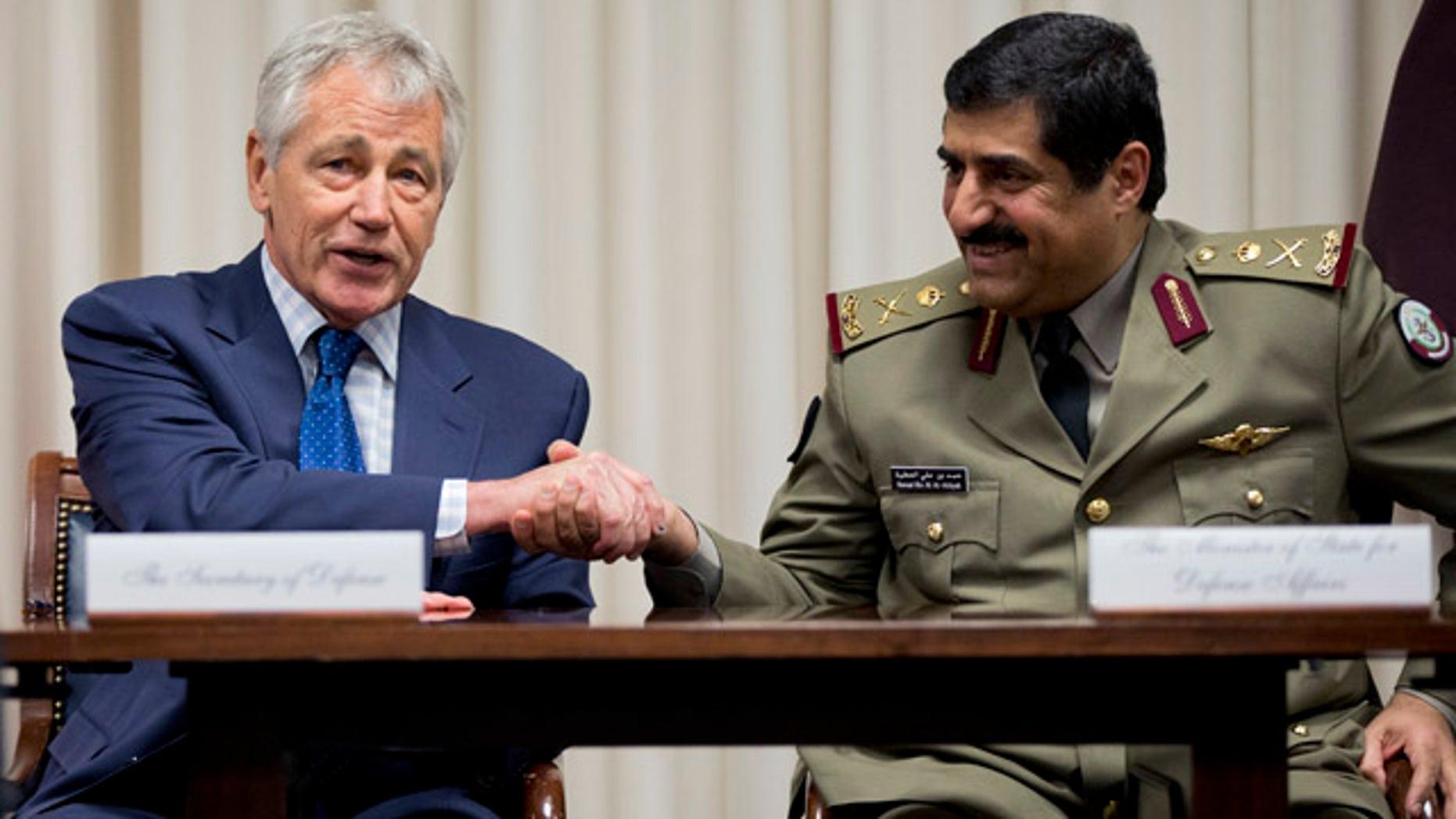 July 14, 2014: Defense Secretary Chuck Hagel, left, shakes hands with Qatari Defense Minister Hamad bin Ali al-Attiyah during a signing ceremony at the Pentagon. (AP Photo/Manuel Balce Ceneta)