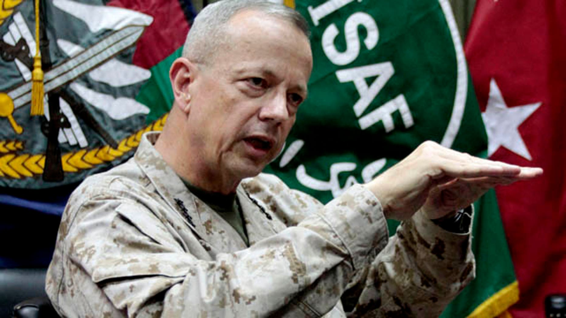 FILE - In this July 22, 2012 file photo, Gen. John Allen gestures during an interview with the Associated Press in Kabul, Afghanistan. Allen will serve as coordinator for the broad international effort to battle the Islamic State group, as nations begin to determine what part each will play. (AP Photo/Musadeq Sadeq, File)