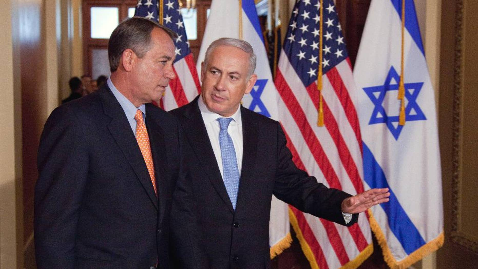 FILE - In this May 24, 2011 file photo, Israeli Prime Minister Benjamin Netanyahu walks with House Speaker  John Boehner of Ohio to make a statement on Capitol Hill in Washington. Boehner has invited Netanyahu to address Congress about Iran. (AP Photo/Evan Vucci, File)