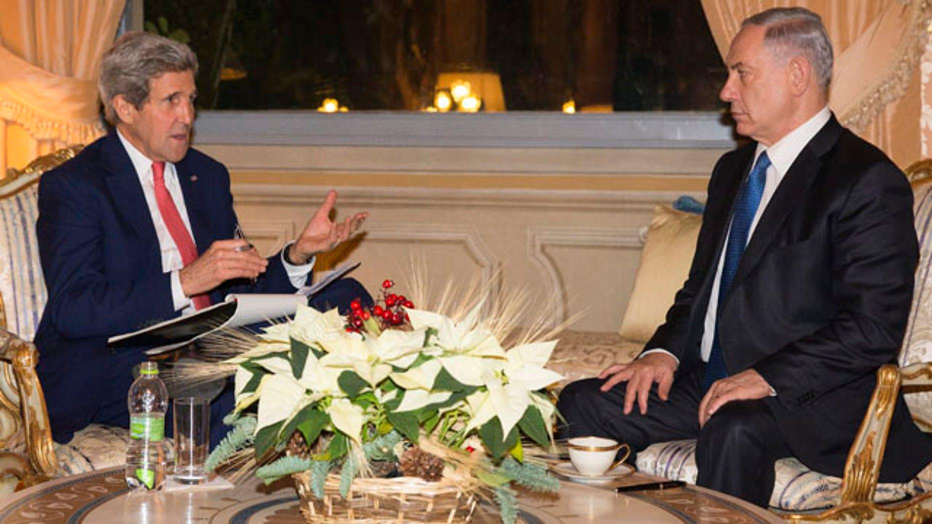FILE - In this Dec. 15, 2014 file-pool photo, Secretary of State, John Kerry meets with Israel Prime Minister Benjamin Netanyahu at Villa Taverna in Rome. (AP Photo/Evan Vucci, File-Pool)