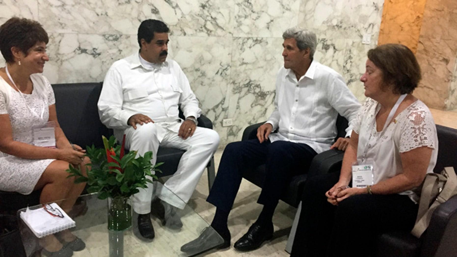 U.S. Secretary of State John Kerry meets with Venezuela president Nicolas Maduro in Cartagena, Colombia Monday, Sept. 26, 2016. (AP Photo/Vivian Salama)