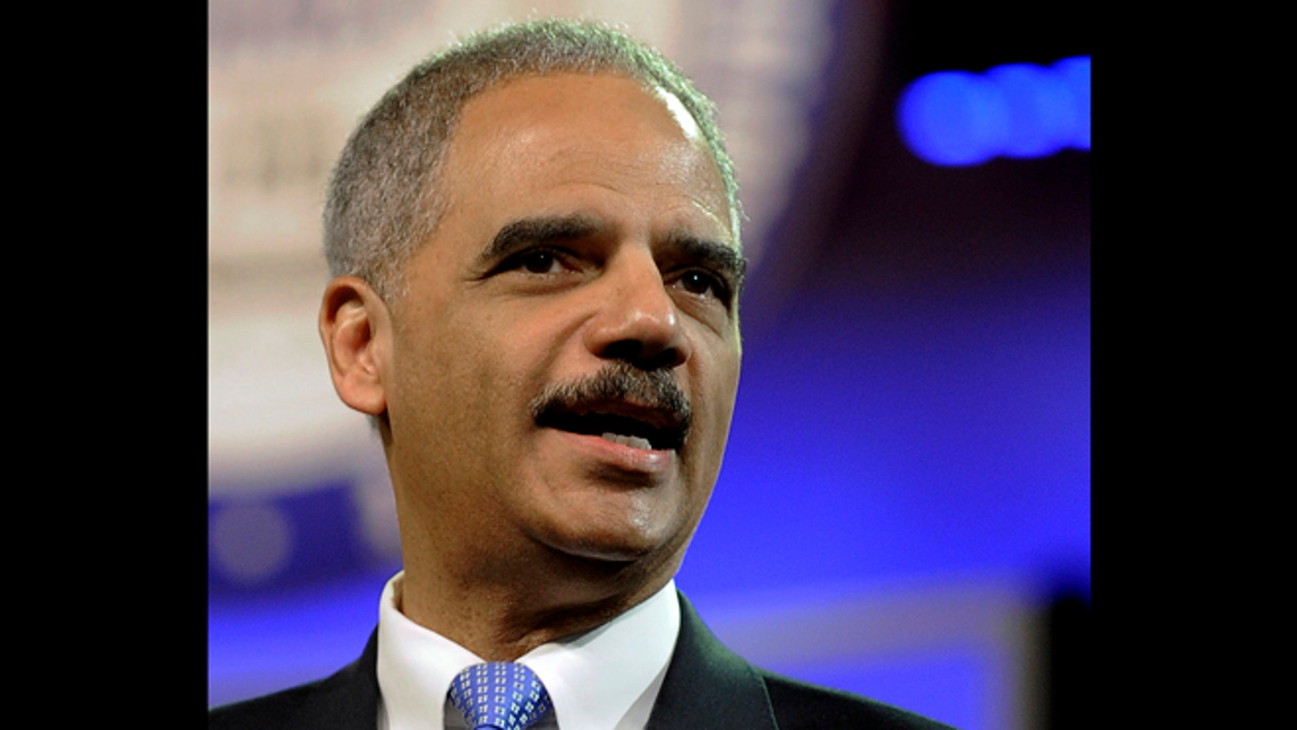 July 10, 2012: File photo, Attorney General Eric Holder speaks in Houston. Holder is cutting short an overseas trip and will return to Washington immediately to manage a criminal investigation into the deaths of the four people who died in an attack on the U.S. Consulate in Benghazi, Libya.