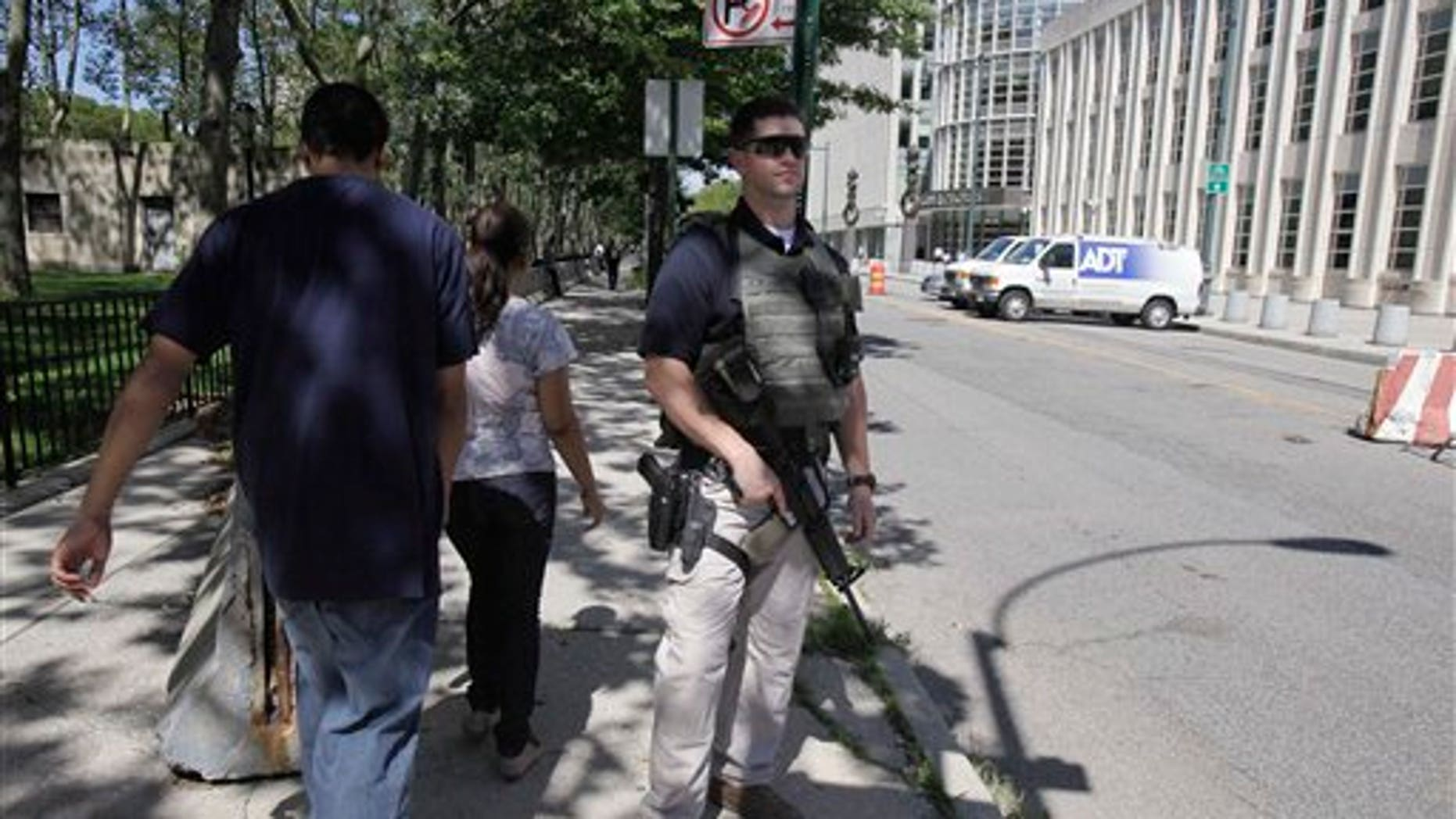 Sept 9: An armed U.S. Marshal stands guard outside the Federal Courthouse in Brooklyn. New York City resident Agron Hasbajrami, in an indictment unsealed in Brooklyn, has been charged with providing material support to a terrorist organization by plotting to travel to Pakistan to join a radical fighting group.