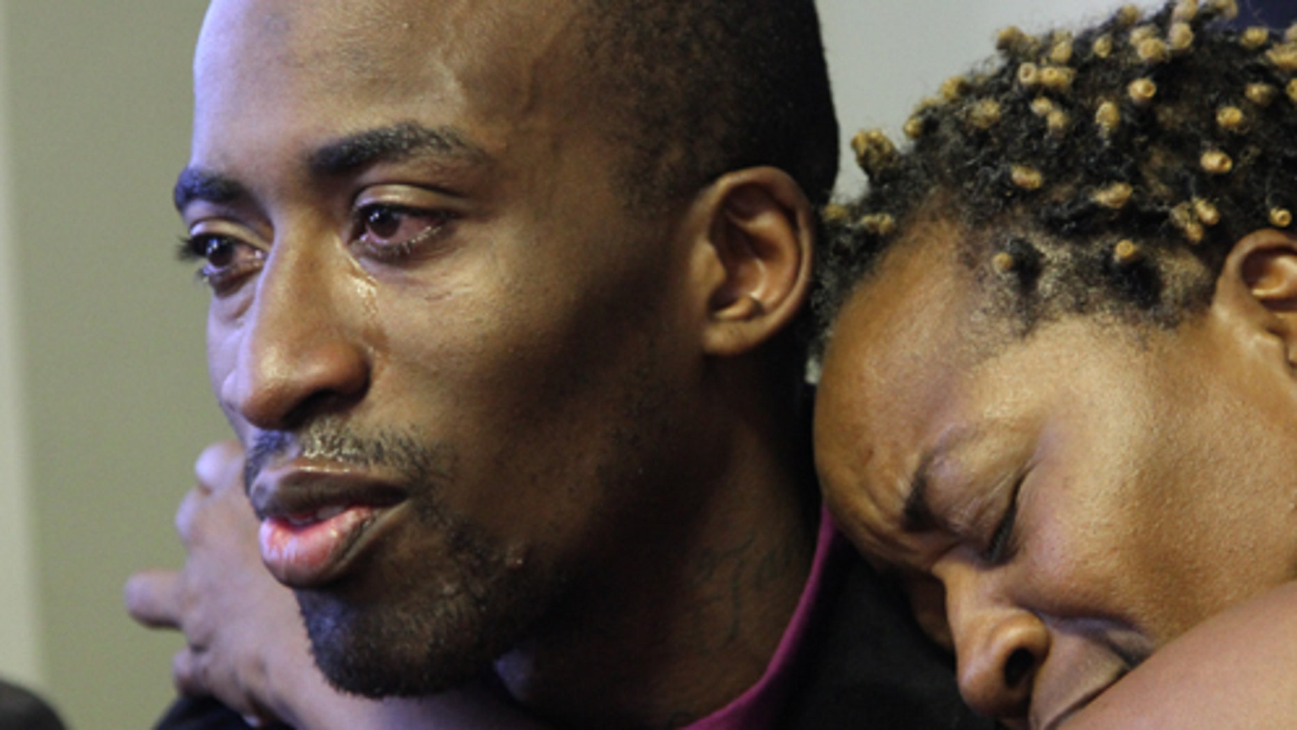 Jabin Bogan is hugged by his mother Aletha Smith as they participate in a news conference on Friday, Nov. 23, 2012 in El Paso, Texas. The 27-year-old Dallas truck driver was released after seven months in a prison in Mexico accused of ammunition smuggling. He was arrested in April after crossing the border by mistake with 268,000 rounds of ammunition. (AP Photo/Juan Carlos Llorca)