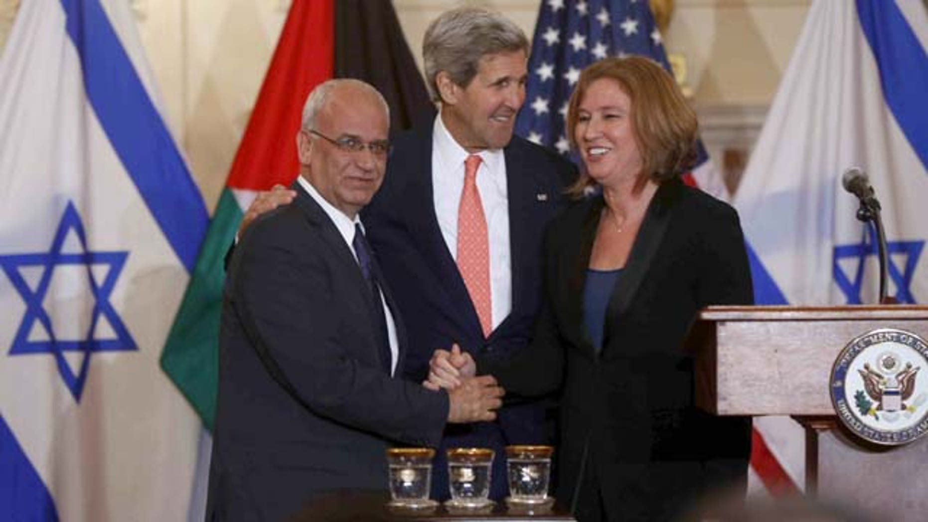 July 30, 2013: Secretary of State John Kerry stands with Israel's Justice Minister and chief negotiator Tzipi Livni, right, and Palestinian chief negotiator Saeb Erekat, after the resumption of Israeli-Palestinian peace talks at the State Department in Washington. (AP Photo)