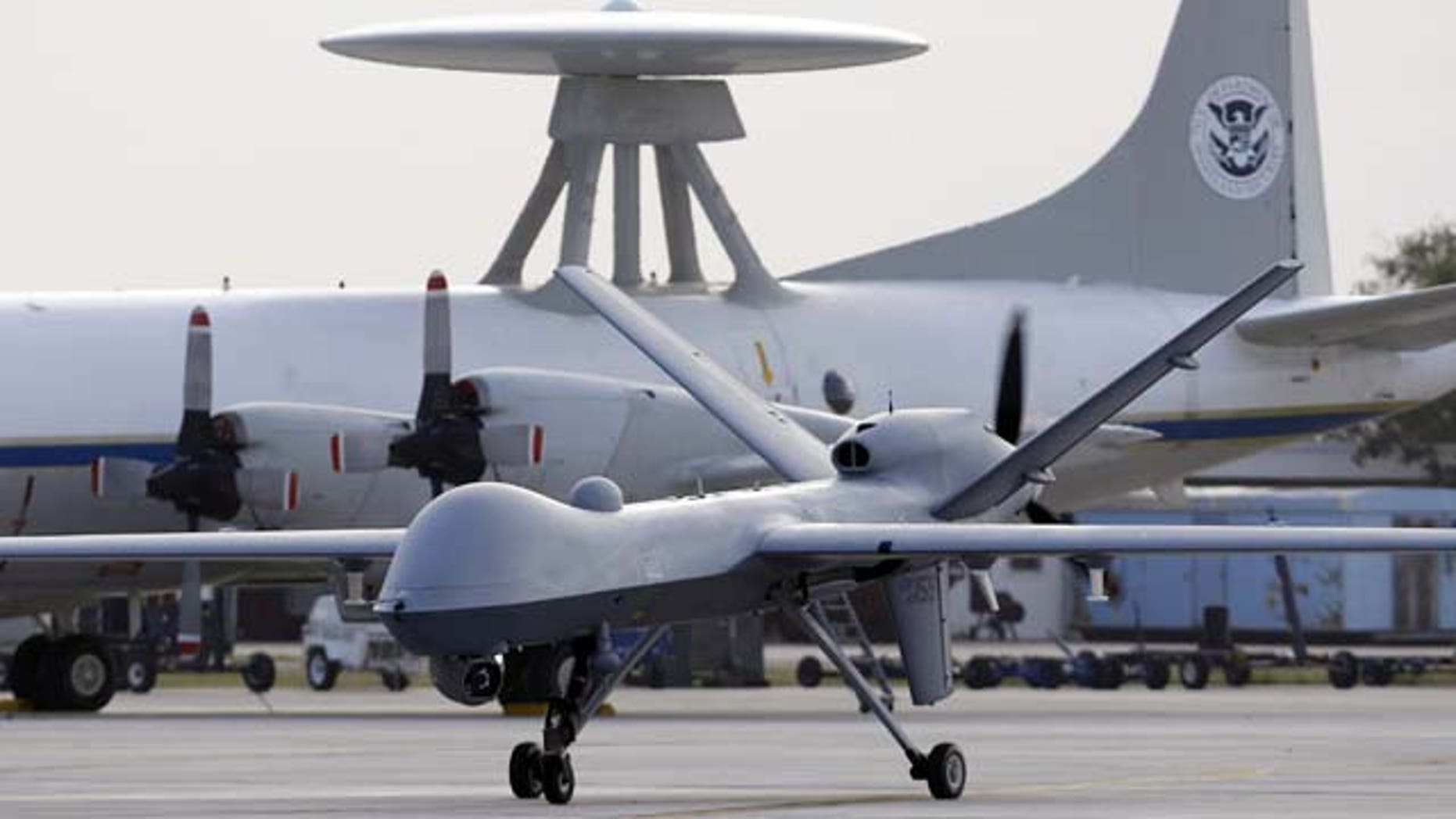 In this Nov. 8, 2011 file photo, a Predator B unmanned aircraft taxis at the Naval Air Station in Corpus Christi, Texas. (AP Photo)